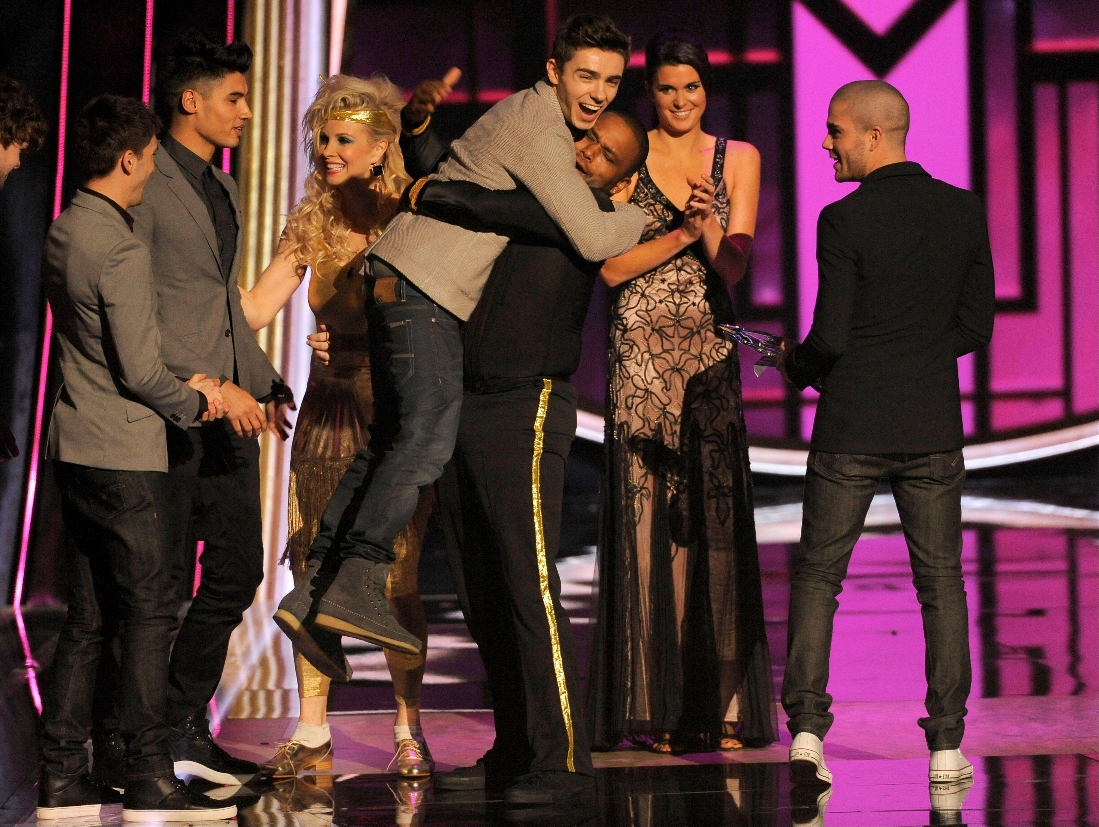 The Wanted accept the award for favorite Breakout artist at the People�s Choice Awards at the Nokia Theatre on Wednesday Jan. 9, 2013, in Los Angeles.