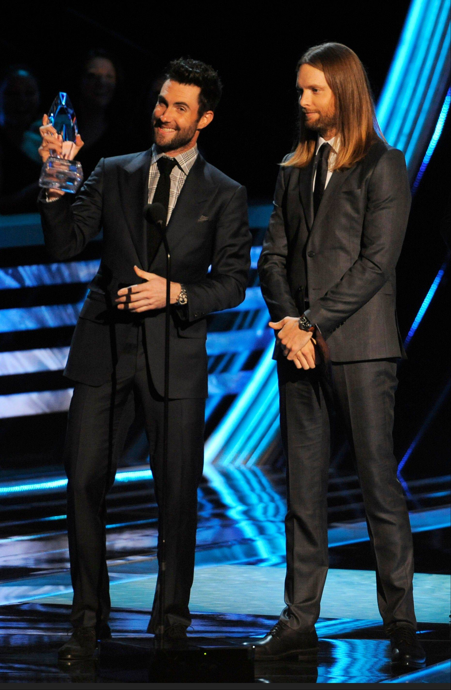 Maroon 5 accept the award for favorite band at the People's Choice Awards at the Nokia Theatre on Wednesday Jan. 9, 2013, in Los Angeles. From left are Adam Levine and James Valentine.