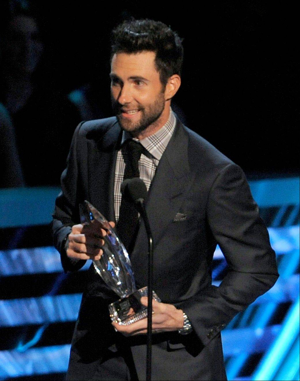 Adam Levine, of Maroon 5, accepts the award for favorite band at the People's Choice Awards at the Nokia Theatre on Wednesday Jan. 9, 2013, in Los Angeles.