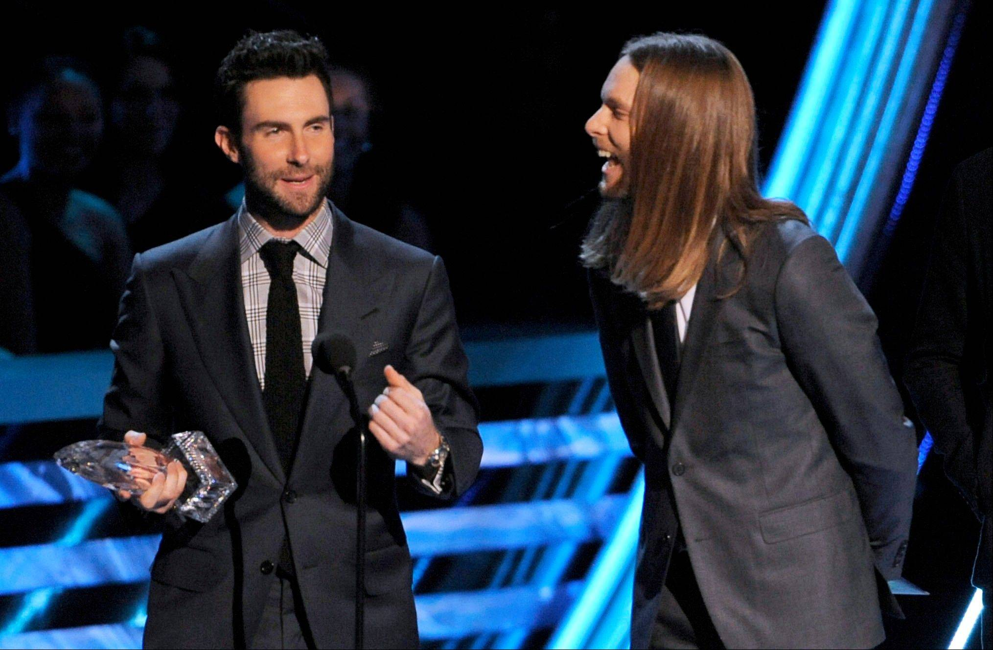 Adam Levine, left, and James Valentine, of Maroon 5, accept the award for favorite band at the People�s Choice Awards at the Nokia Theatre on Wednesday Jan. 9, 2013, in Los Angeles.