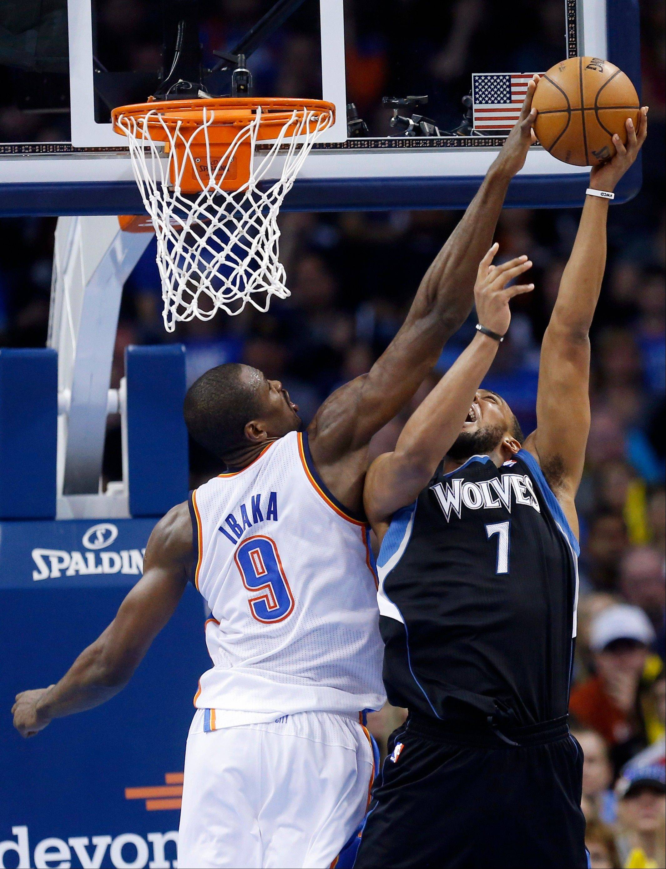 Oklahoma City Thunder forward Serge Ibaka (9) blocks a shot by Minnesota Timberwolves forward Derrick Williams (7) in the third quarter of an NBA basketball game in Oklahoma City, Wednesday, Jan. 9, 2013. Oklahoma City won 106-84.