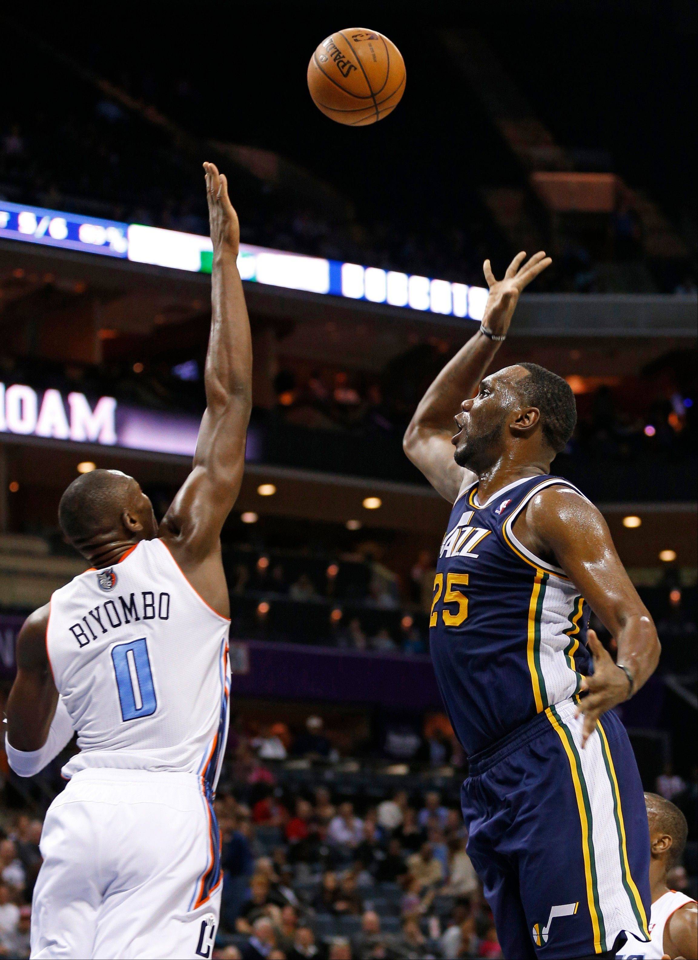 Utah Jazz's Al Jefferson (25) shoots over Charlotte Bobcats' Bismack Biyombo (0) during the first half of an NBA basketball game in Charlotte, N.C., Wednesday. The Jazz won 112-102.