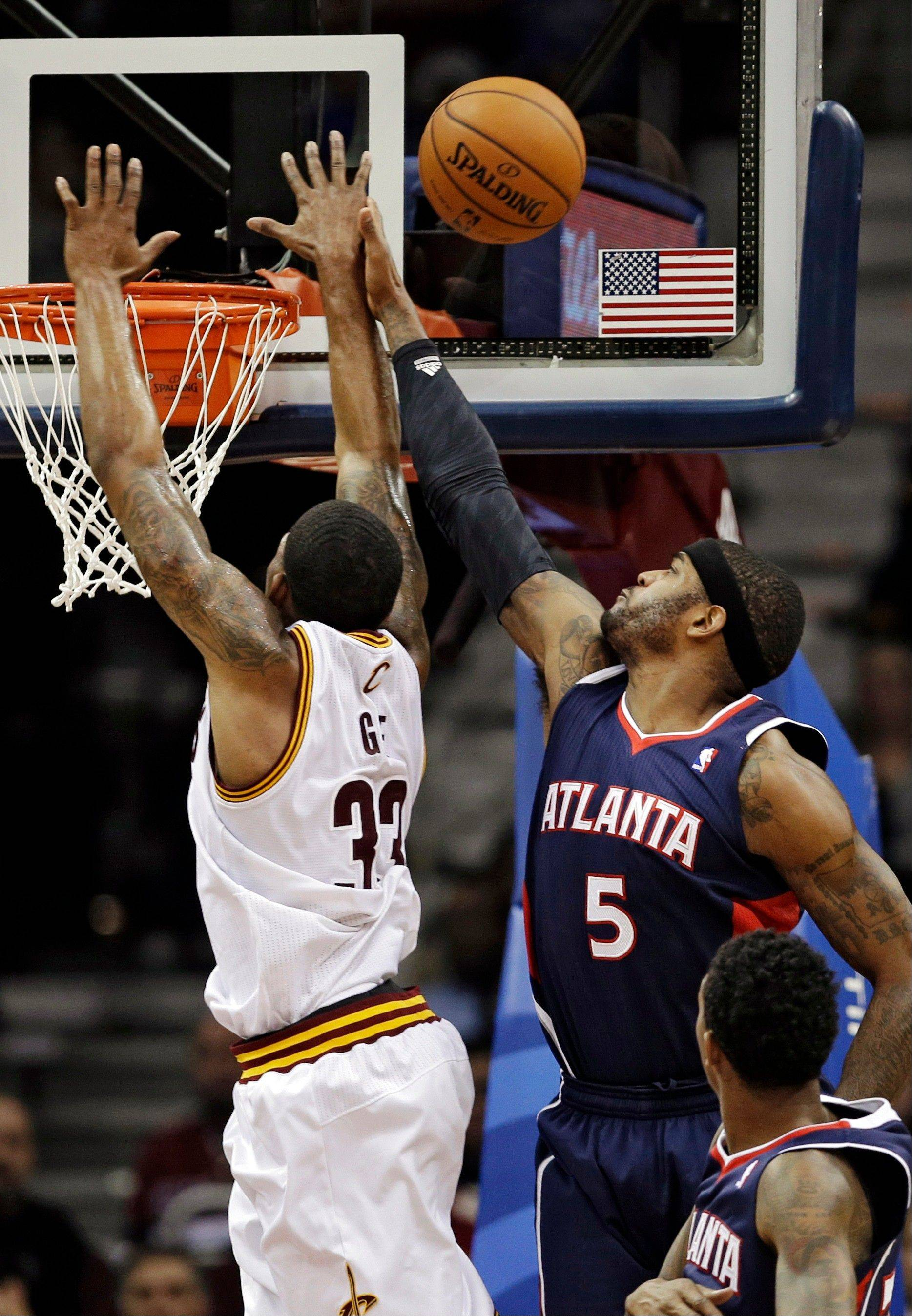 Atlanta Hawks' Josh Smith (5) blocks a shot by Cleveland Cavaliers' Alonzo Gee (33) in the third quarter of an NBA basketball game Wednesday in Cleveland. Smith led the Hawks with 17 points in a 99-83 loss to the Cavaliers.