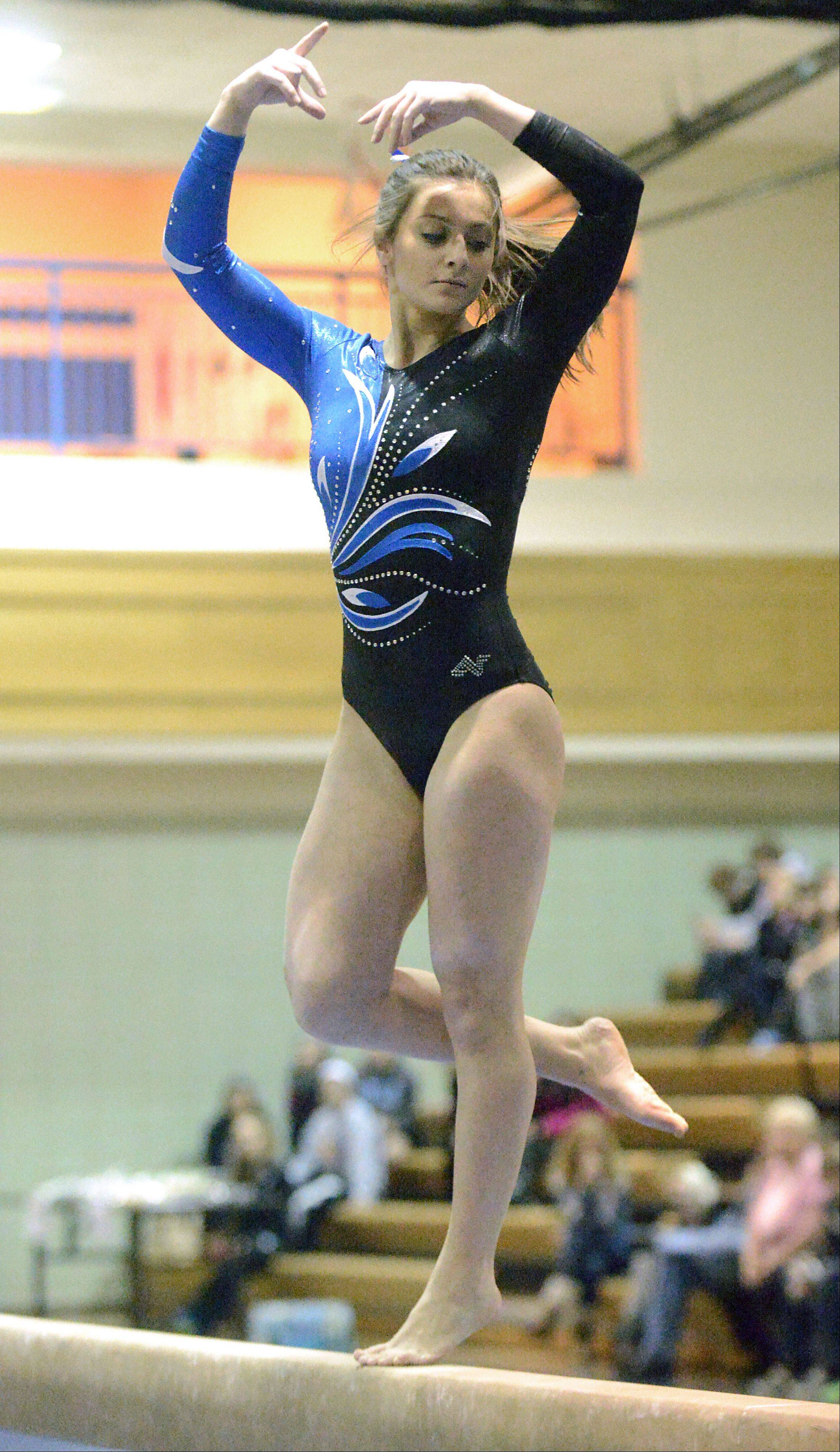 Geneva's Dominque Brognia competes on the beam on Wednesday, January 9.