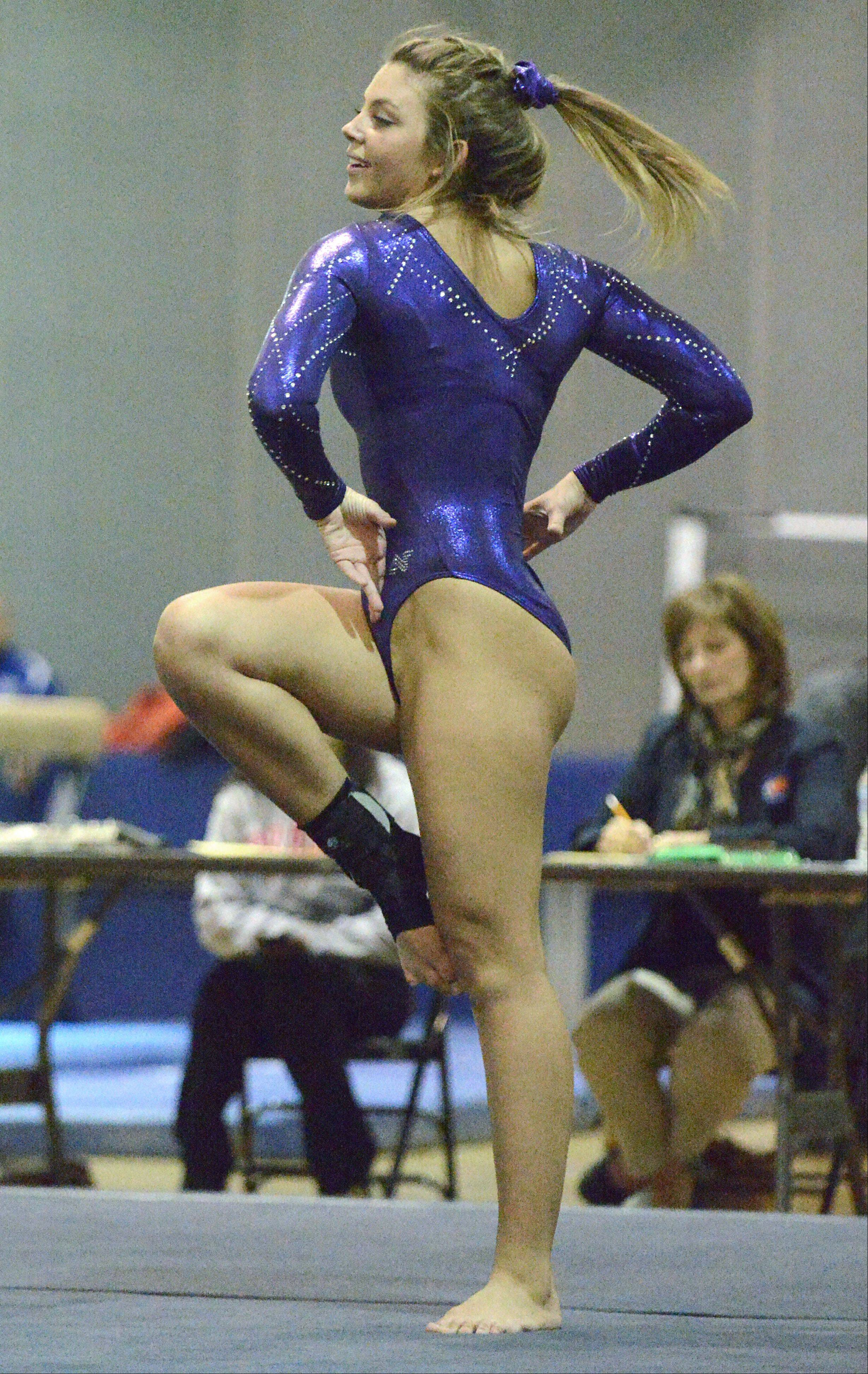 St. Charles' Jesi Ortiz performs her floor routine on Wednesday, January 9.