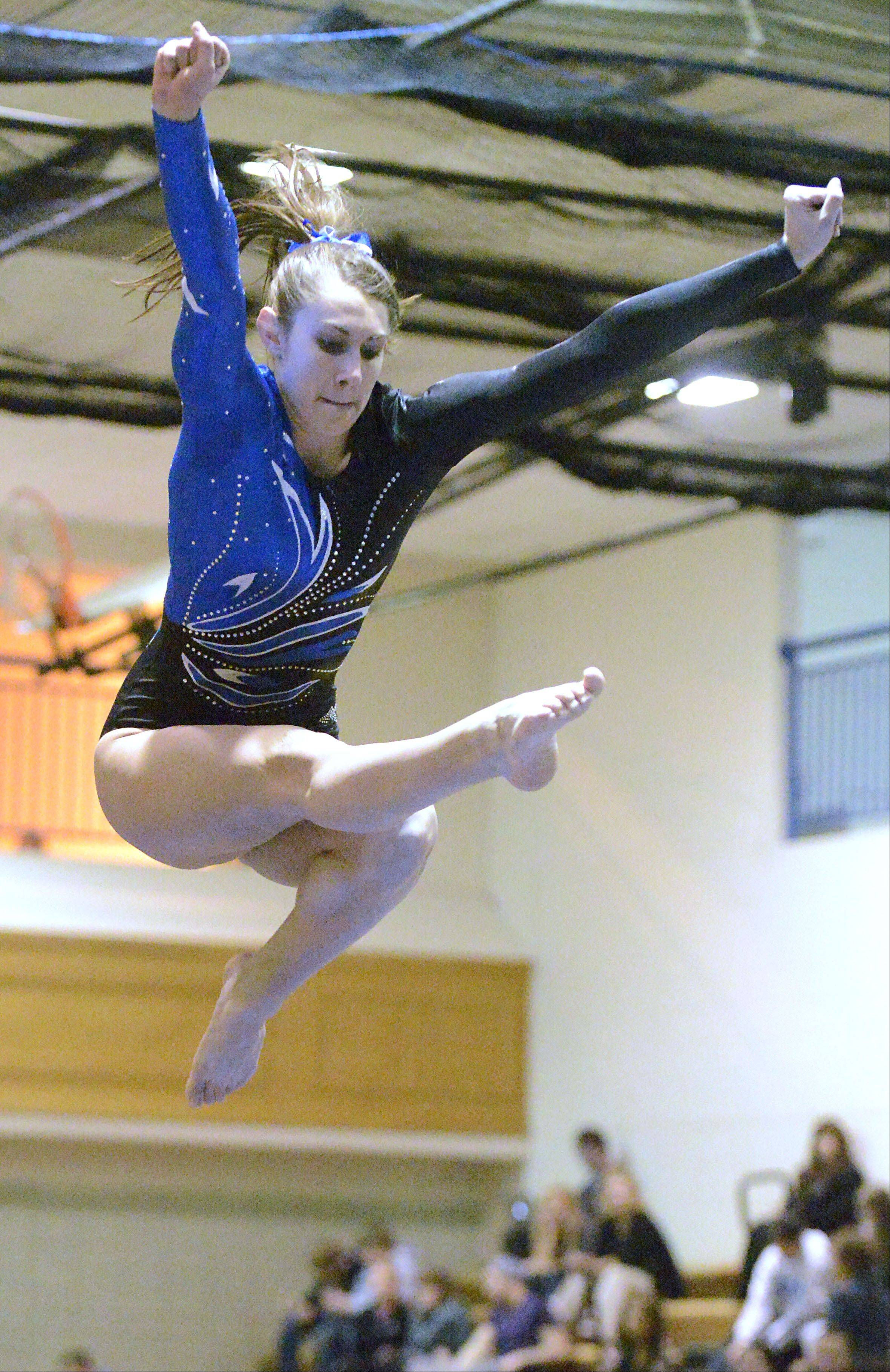 Geneva's Ashley Puff competes on the beam on Wednesday, January 9.