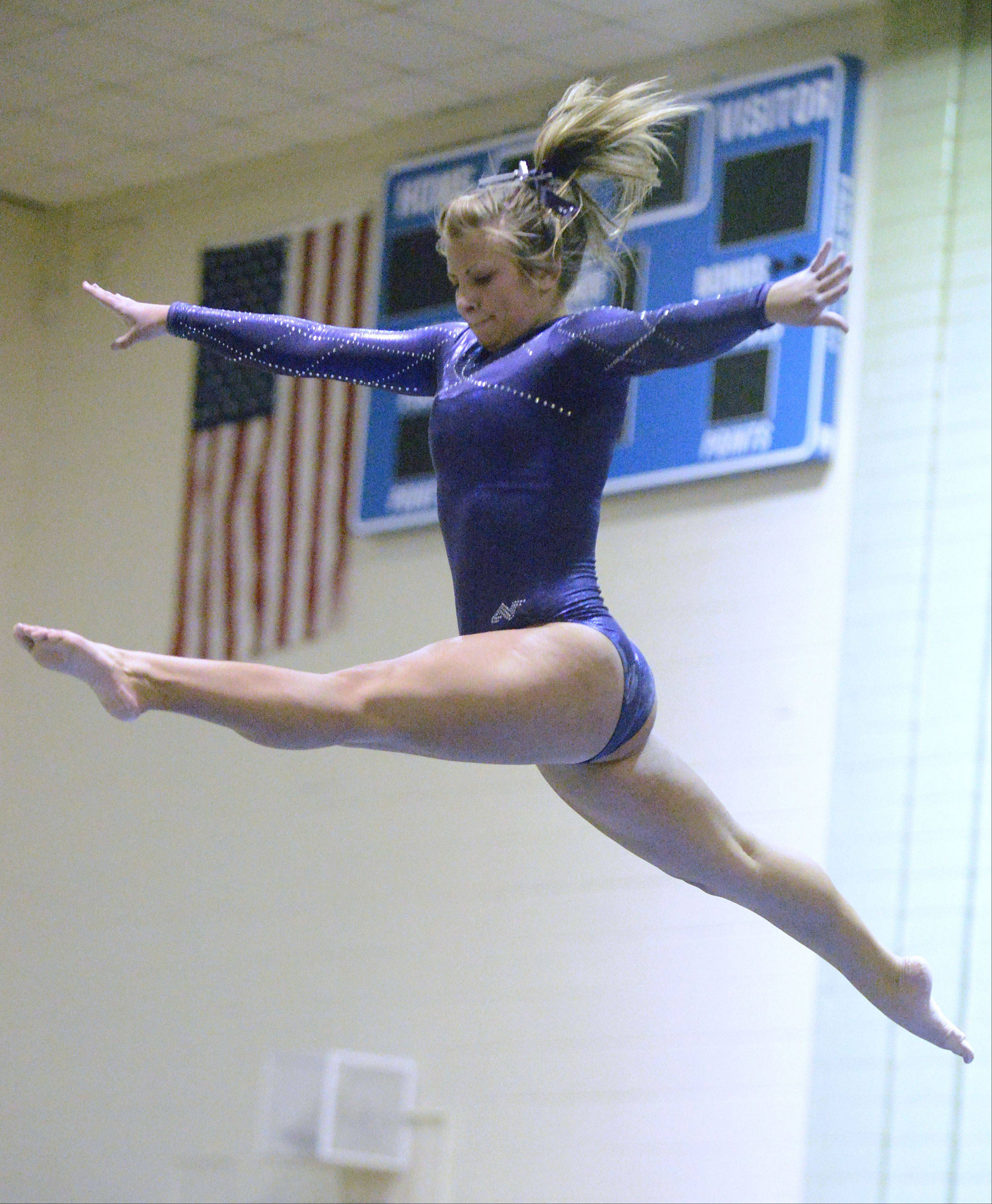 St. Charles' Kelly Gorniak performs her beam routine on Wednesday, January 9.