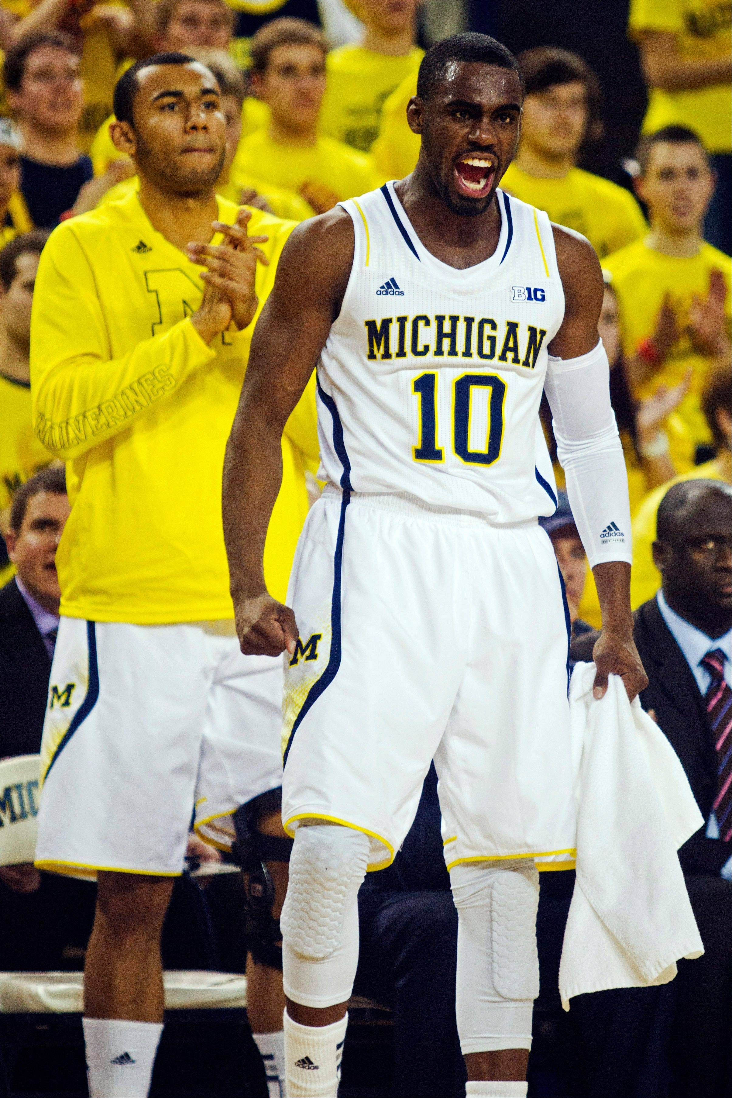 Michigan guard Tim Hardaway Jr., (10) celebrates alongside forward Jon Horford in the first half of an NCAA college basketball game against Nebraska on Wednesday at Crisler Center in Ann Arbor, Mich. Michigan won 62-47.