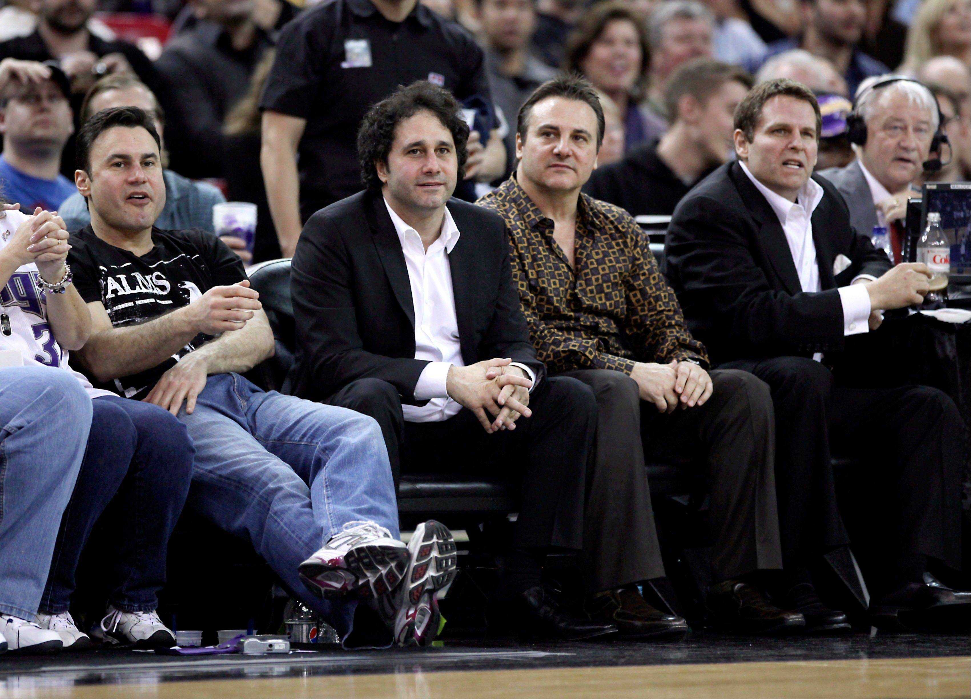 In this Dec. 26, 2009, photo, from left, brothers Phil, George, Gavin and Joe Maloof, owners of the Sacramento Kings, watch an NBA basketball game against the Los Angeles Lakers in Sacramento, Calif. People with knowledge of the situation said Wednesday, Jan. 9, 2013, that investor Chris Hansen has contacted the Maloof family about buying the Kings.