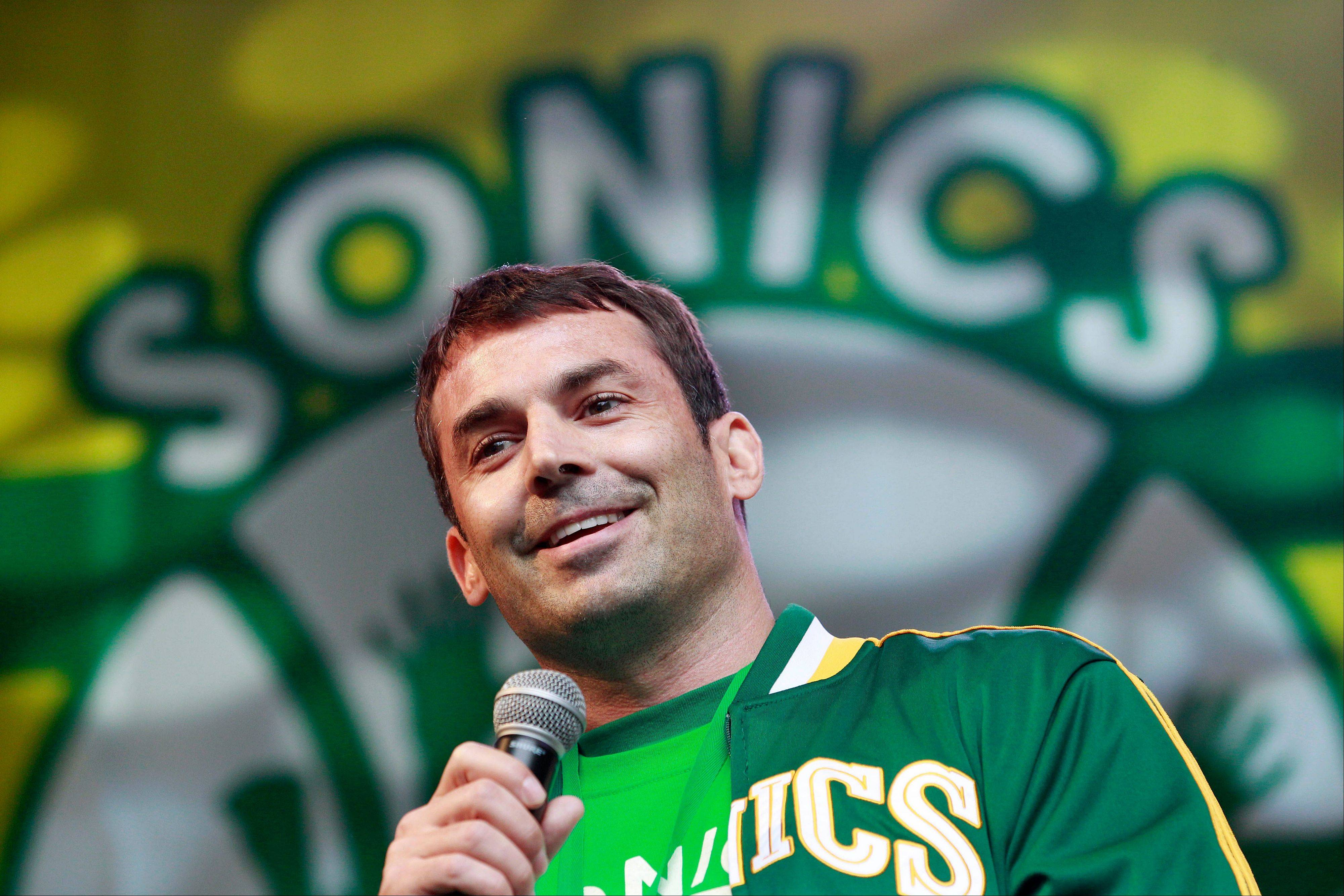 In this June 14, 2012, file photo, investor Chris Hansen smiles as he speaks to supporters of a proposal for a new NBA arena during a rally in Seattle. People with knowledge of the situation said Wednesday, Jan. 9, 2013, that Hansen has contacted the Maloof family about buying the Sacramento Kings. The people spoke on condition of anonymity because no deal has been reached. The Kings' future in Sacramento has been uncertain because the Maloofs and the city haven't been able to come up with a long-term arena solution.