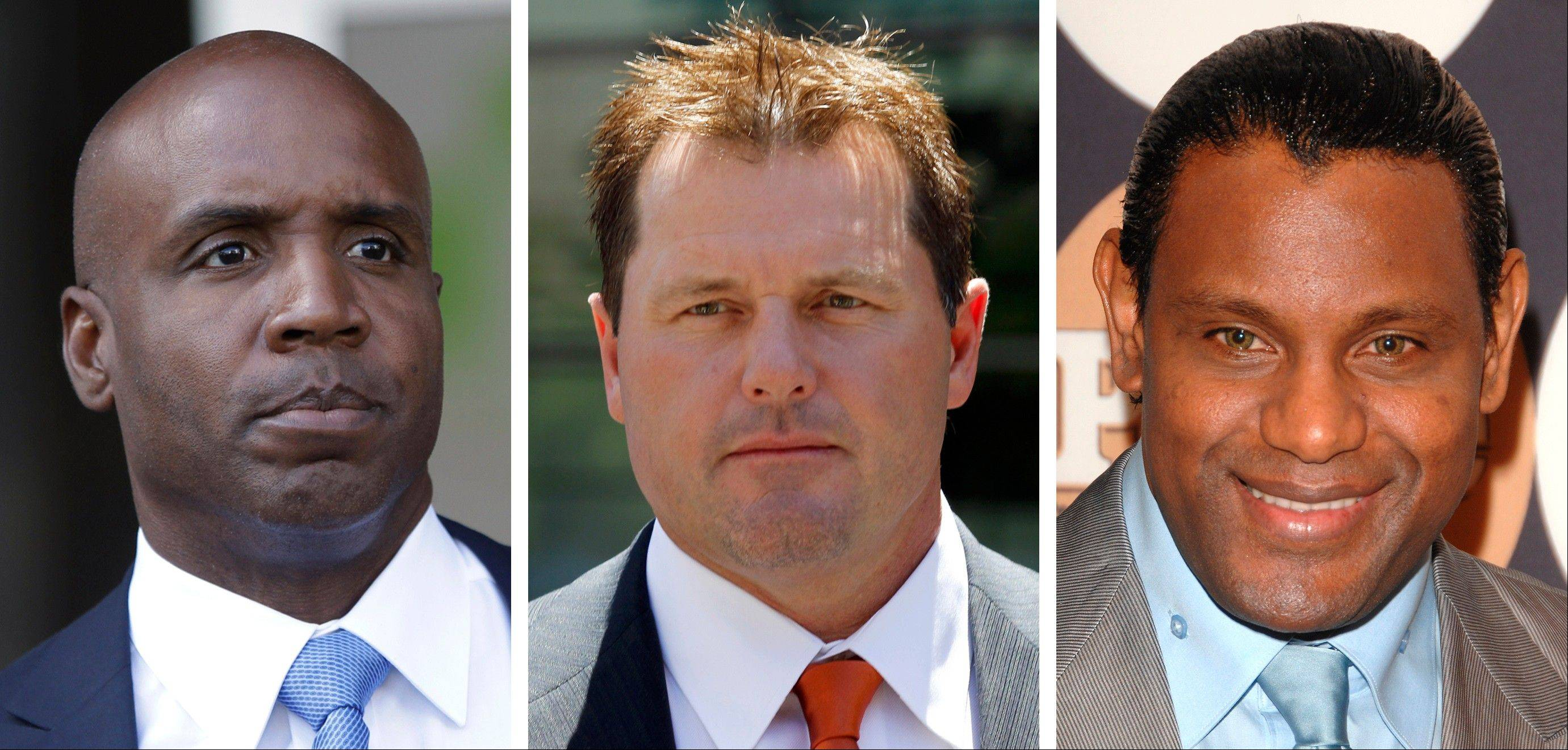 Former San Francisco Giants baseball player Barry Bonds, left, former pitcher Roger Clemens and former Cubs slugger Sammy Sosa didn't get enough votes for entrance to the National Baseball Hall of Fame. Sosa was far behind Bonds and Clemens.