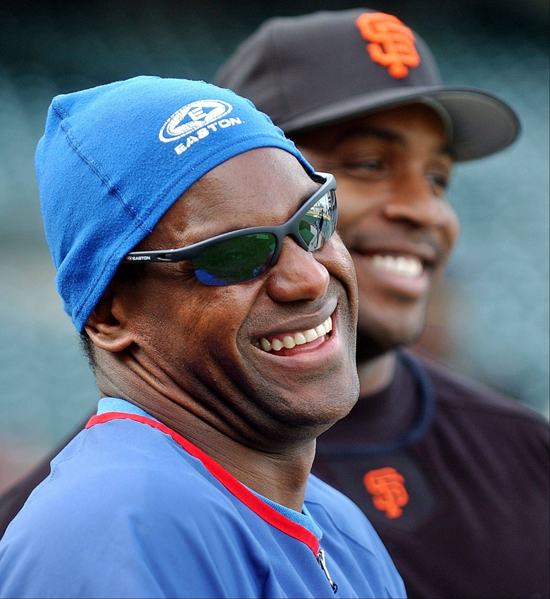 Cubs outfielder Sammy Sosa, left, and San Francisco Giants outfielder Barry Bonds smile during batting practice. Baseball Hall of Fame voters didn't elect any players to the hall of fame this year.