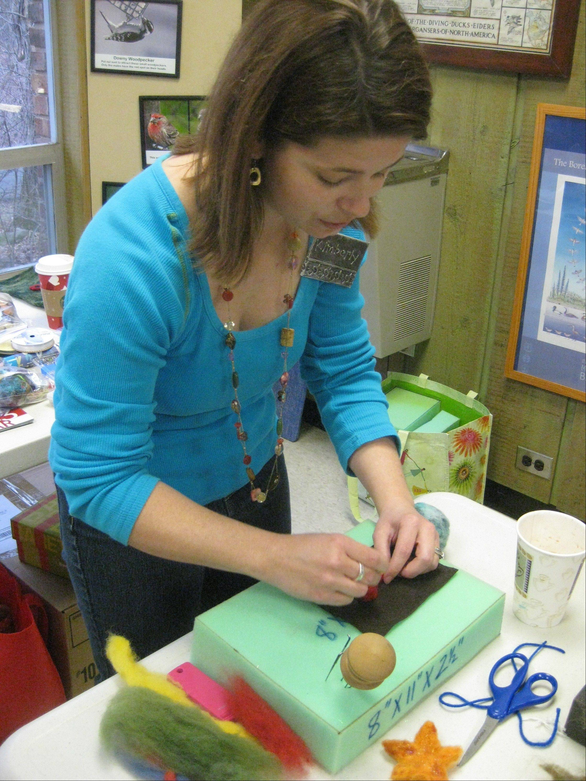 Artist Kimberly Butts demonstrates how to felt wool during a workshop at Crabtree Nature Center in Barrington Hills.