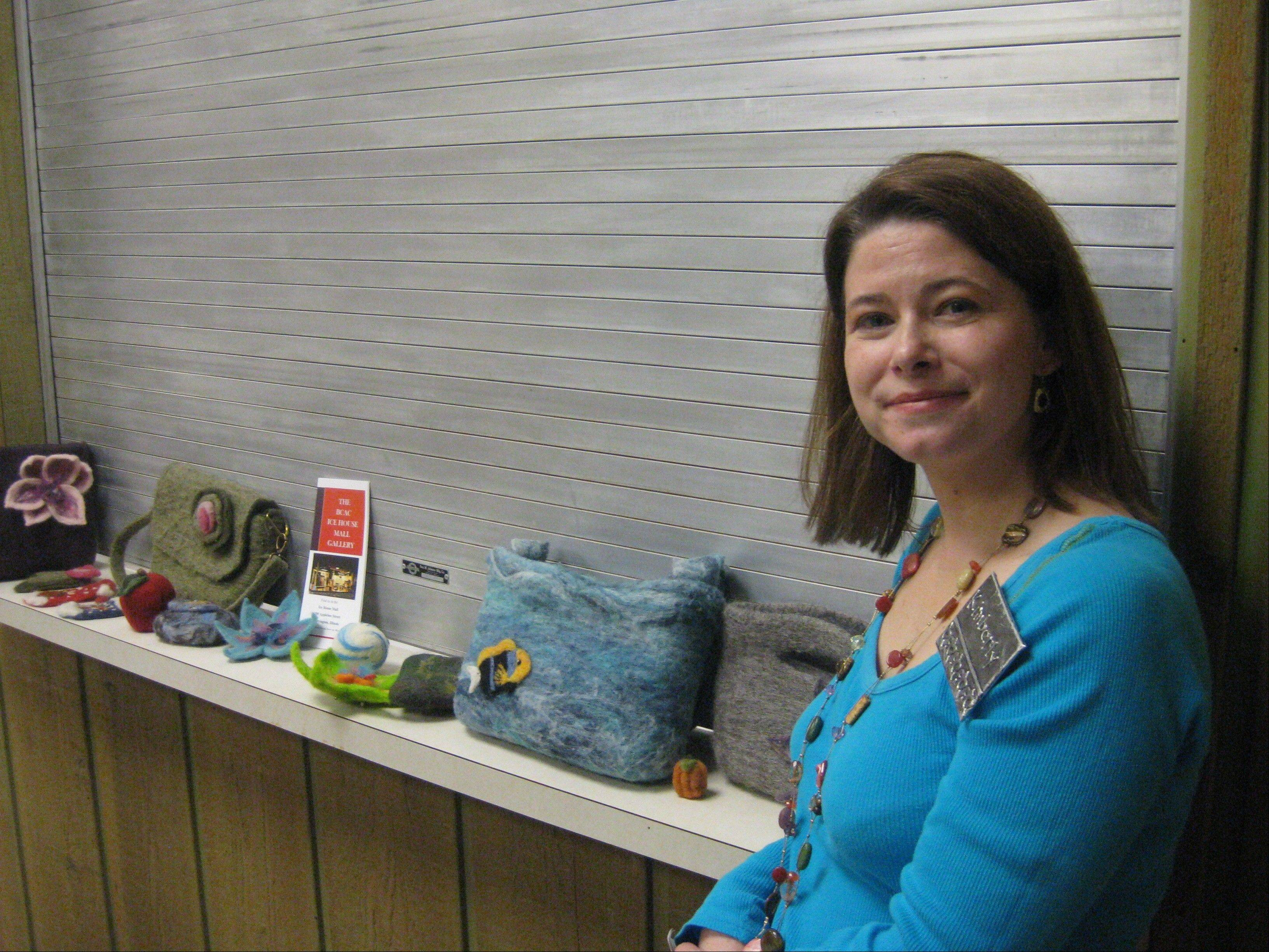 Artist Kimberly Butts displays some of her work from purses to pictures at Crabtree Nature Center in Barrington Hills.