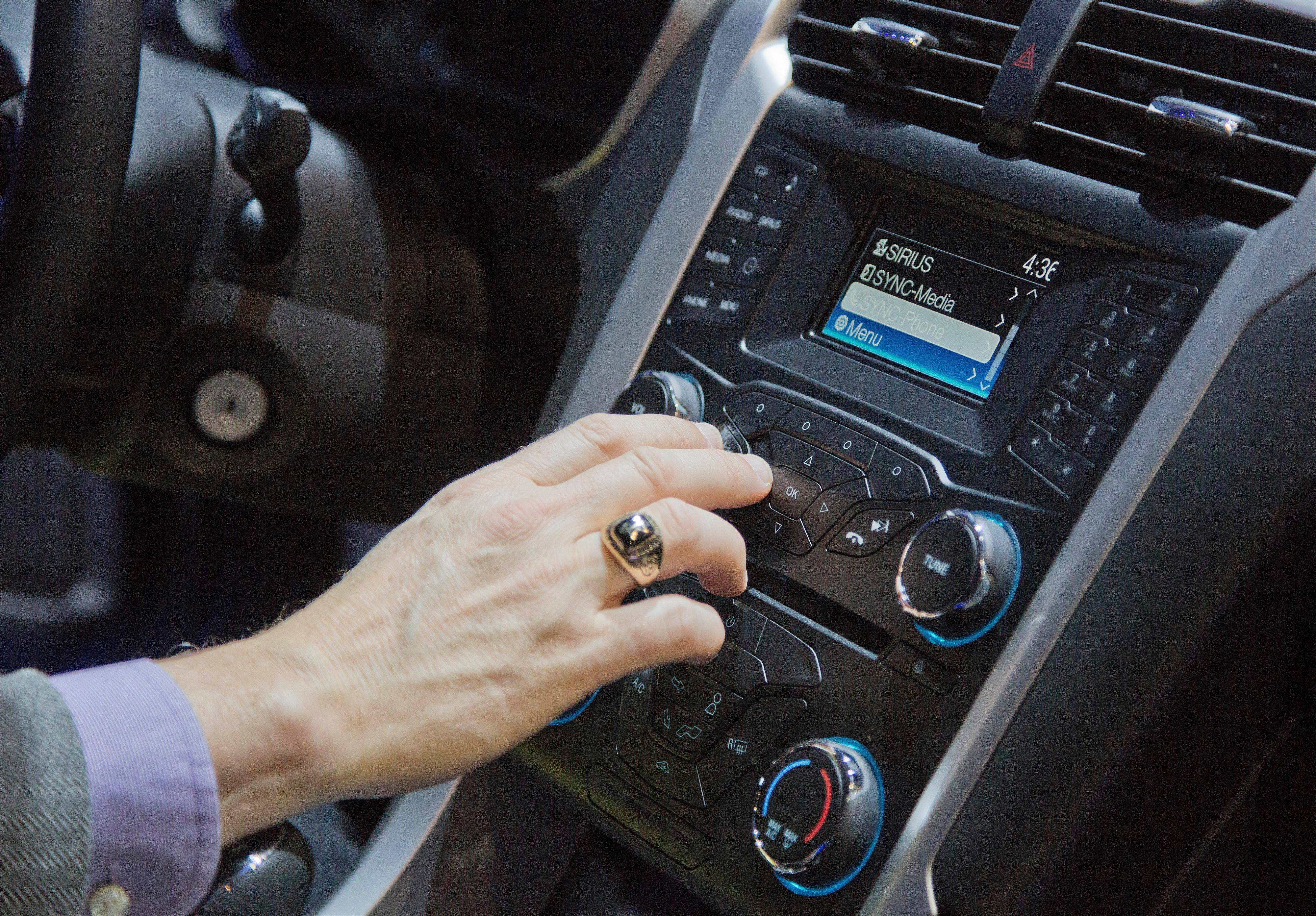 Ford�s SYNC connection and entertainment system is tested inside a Ford Fusion at the Consumer Electronics Show in Las Vegas. Ford�s SYNC connects the car stereo and navigation system to a user�s mobile device.