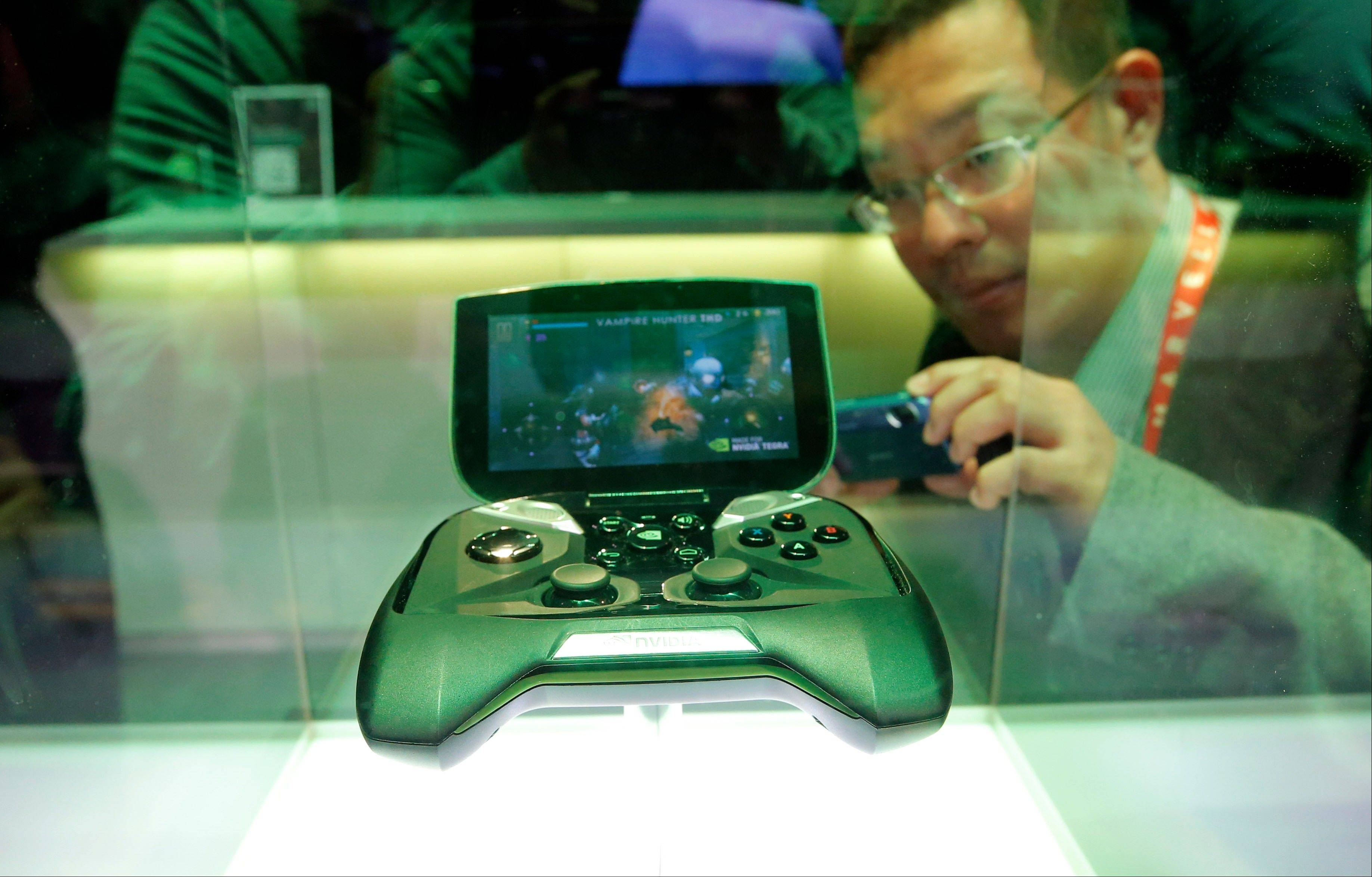 NVIDIA�s portable handheld gaming device, the Project Shield, is on display at the NVIDIA booth at the International Consumer Electronics Show in Las Vegas, Tuesday, Jan. 8, 2013.