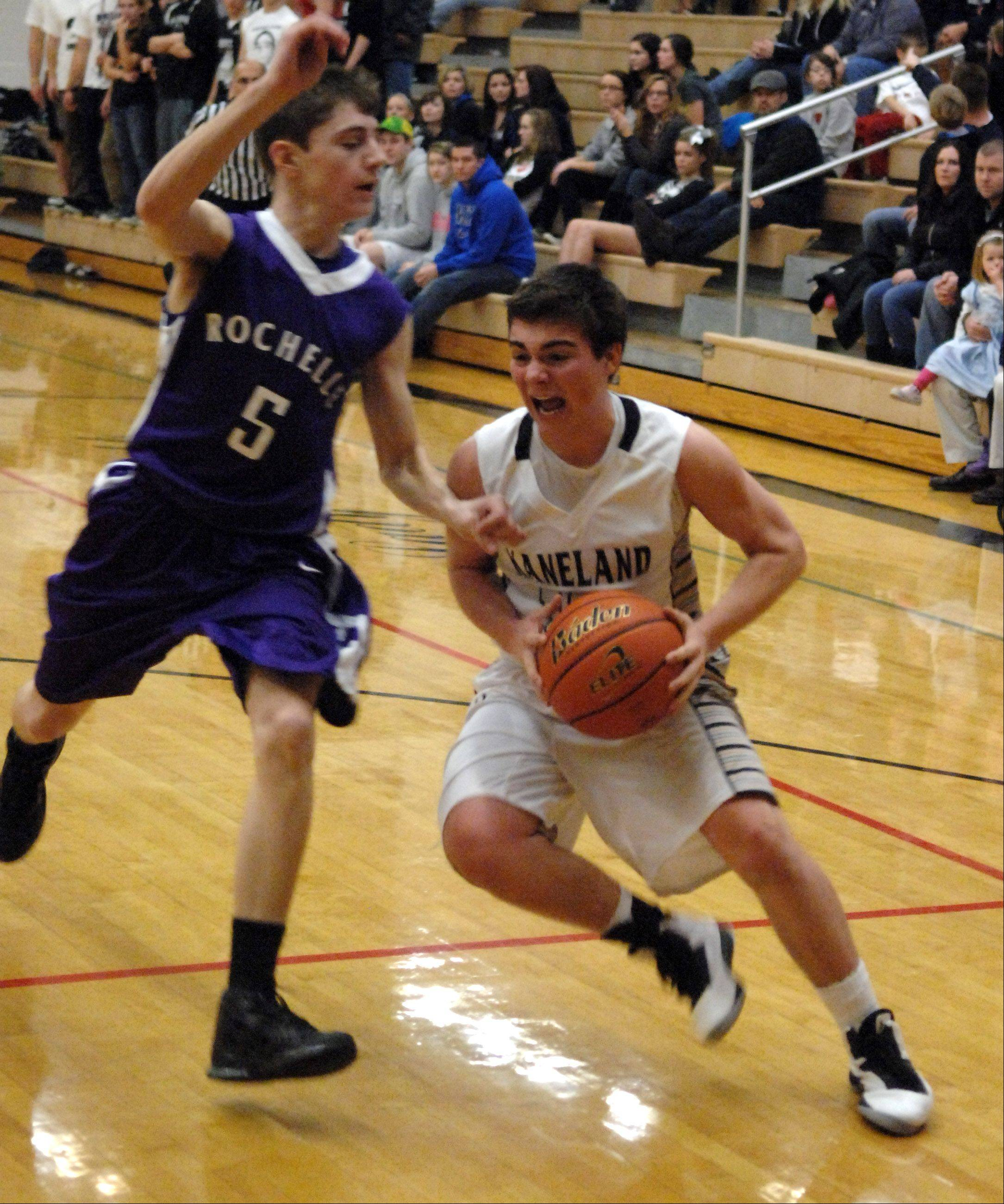 Kaneland�s Connor Fedderly tries to drive the baseline as he is defended by Rochelle�s Aaron Mehrings.