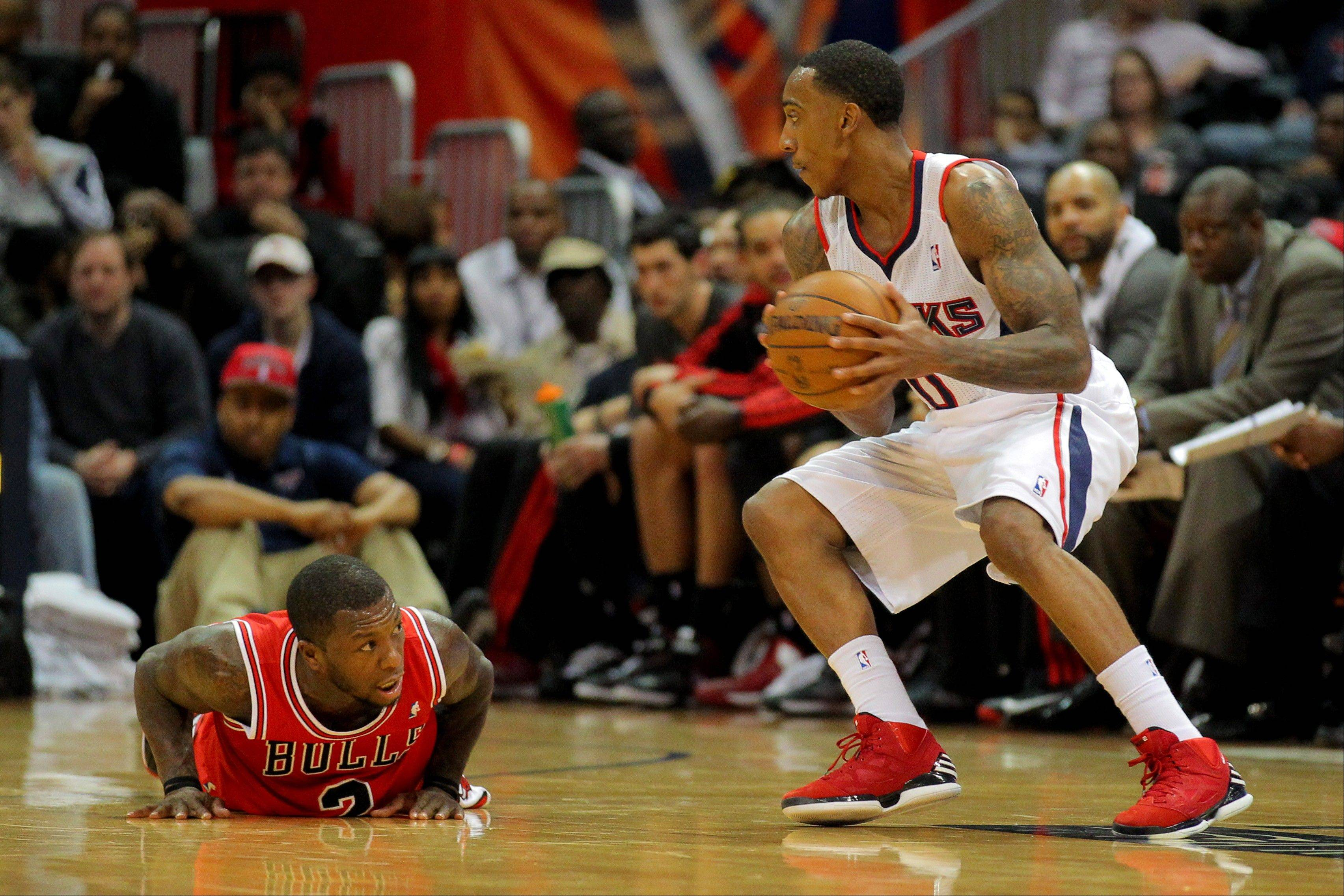 Chicago Bulls guard Nate Robinson (2) falls as Atlanta Hawks guard Jeff Teague (0) recovers the ball in the second half of an NBA basketball game, Saturday, Dec. 22, 2012, in Atlanta. The Hawks won 92-75 (AP Photo/Todd Kirkland)