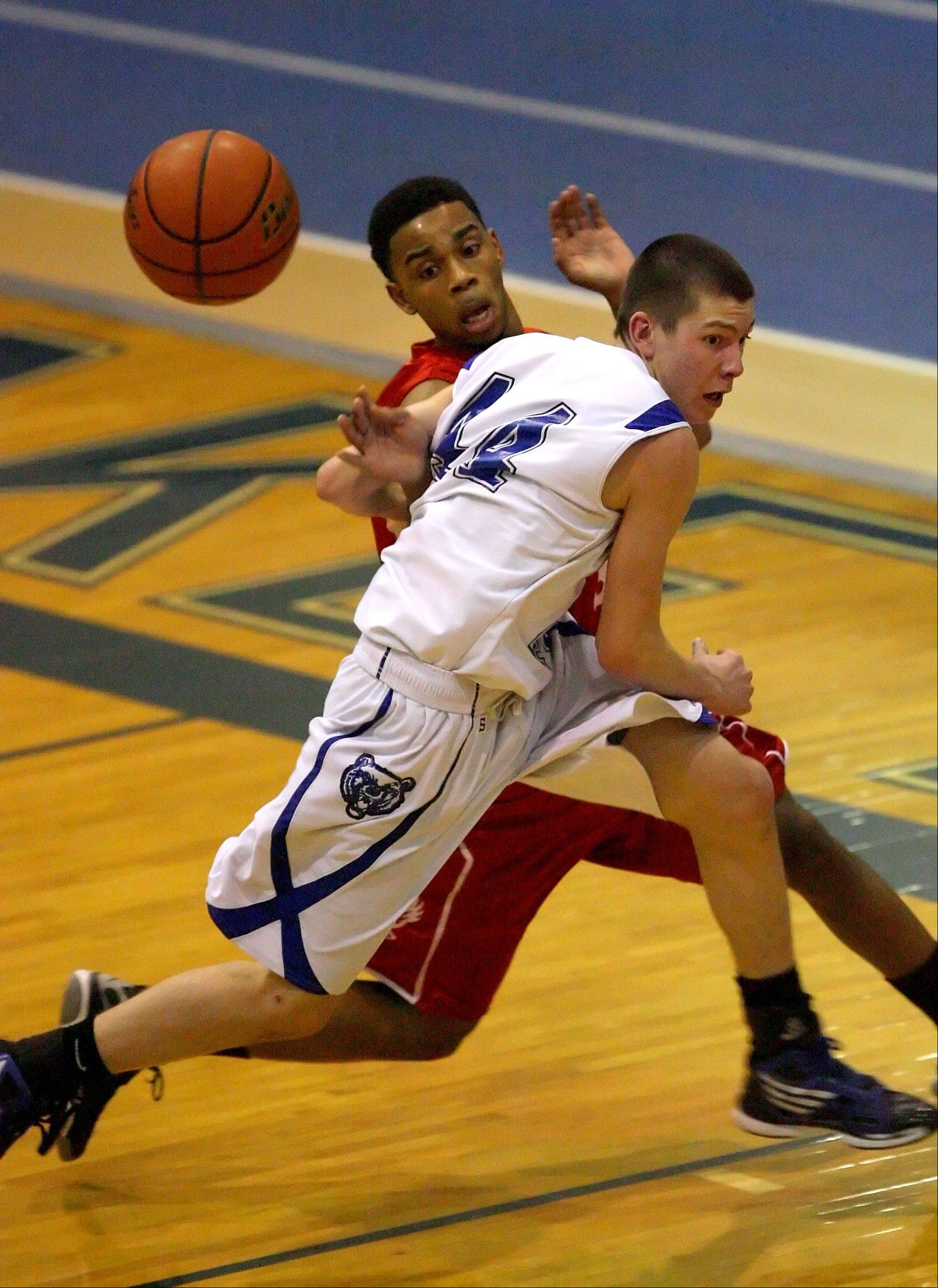 Lake Zurich�s Ryan Roach battles for a loose ball against North Chicago�s Marzhone Bryant last season. Roach is among the scoring leaders for the Bears this year.