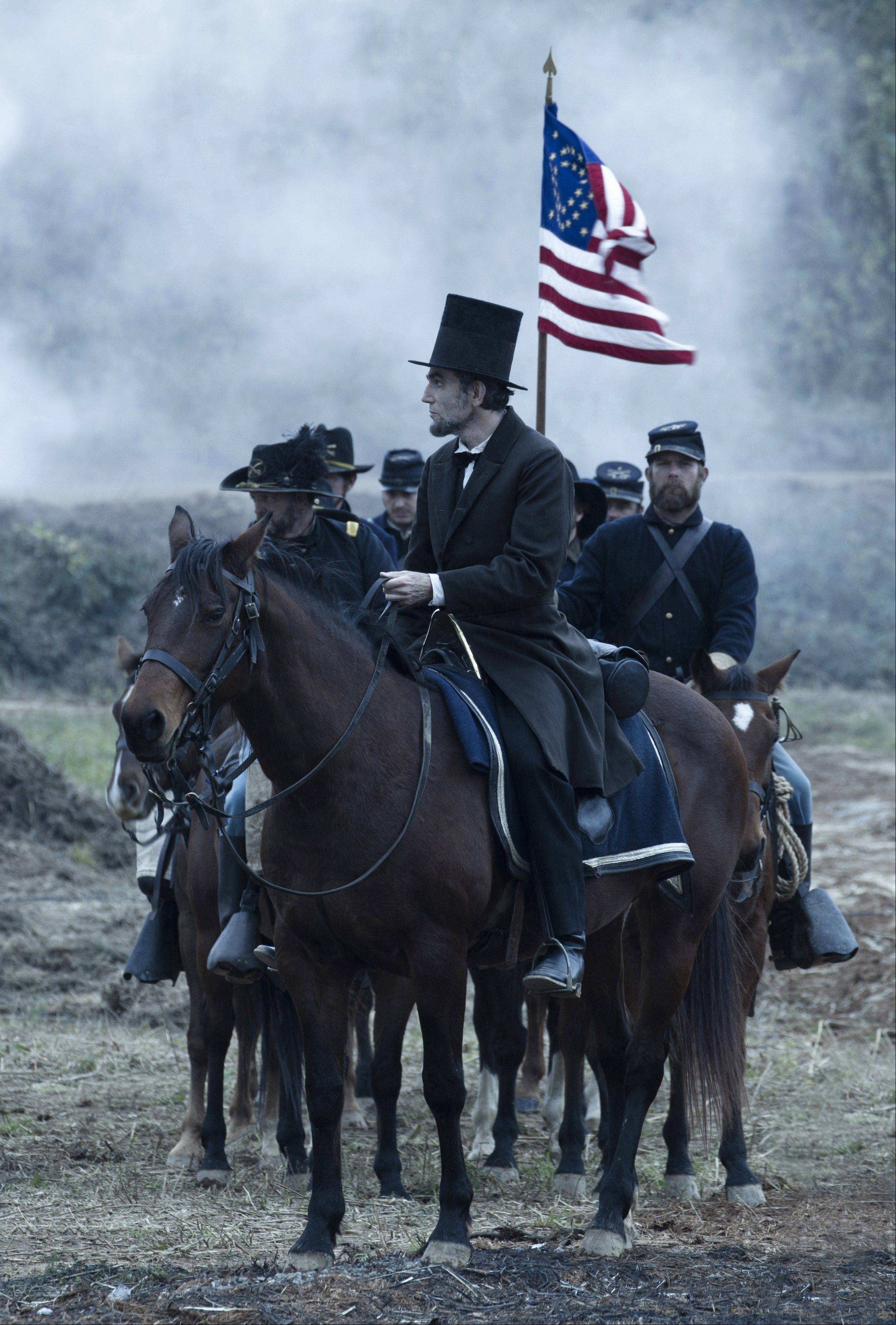"The U.S. President (Daniel Day-Lewis) surveys a Union vs. Confederacy battlefield in Steven Spielberg's ""Lincoln,"" which leads the Academy Awards with 12 nominations."