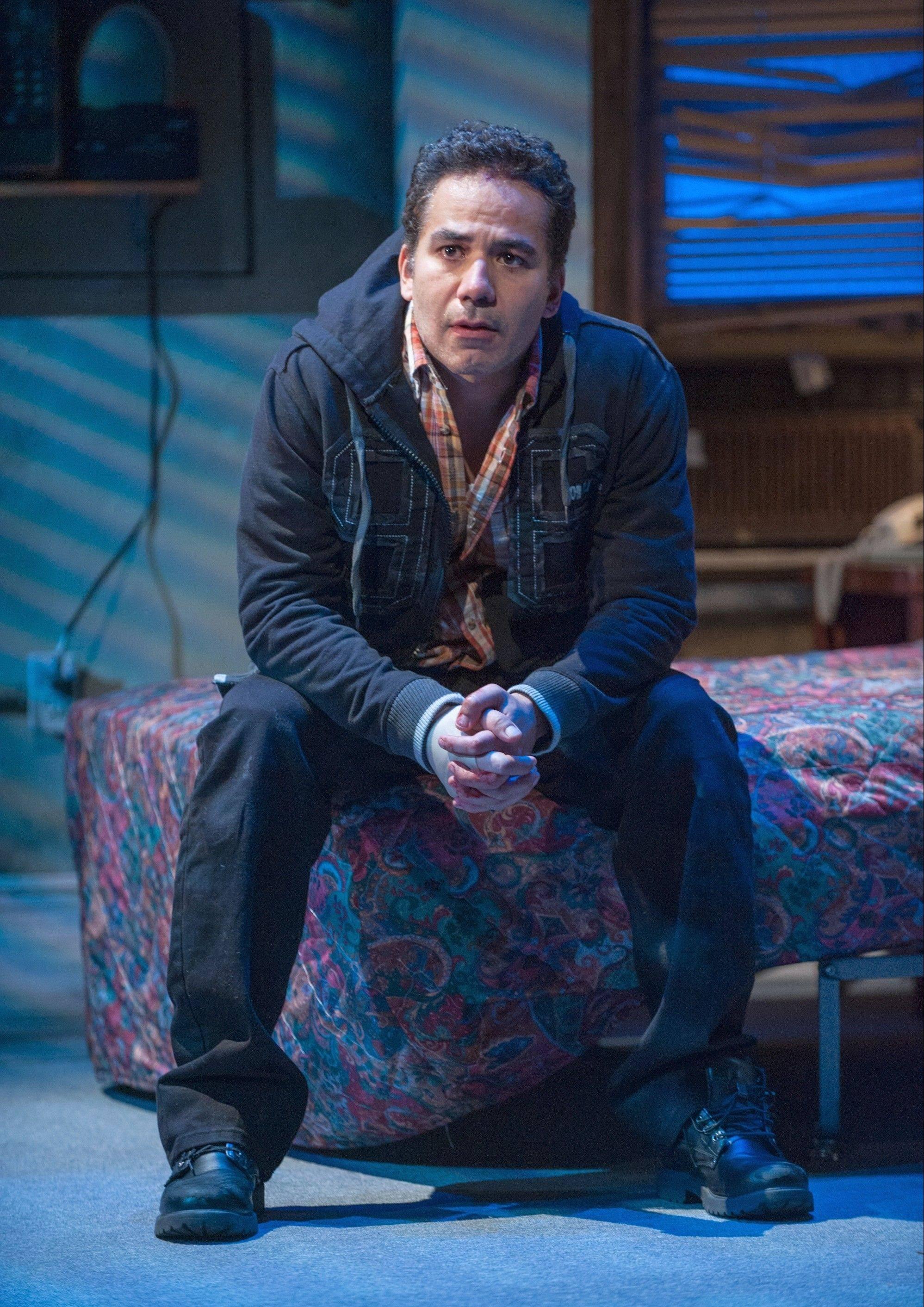 "John Ortiz stars as Jackie, an ex-con trying to negotiate sobriety and a relationship with his childhood sweetheart in Steppenwolf Theatre's Chicago area premiere of Stephen Adly Guirgis' ""The (expletive) with the Hat."""