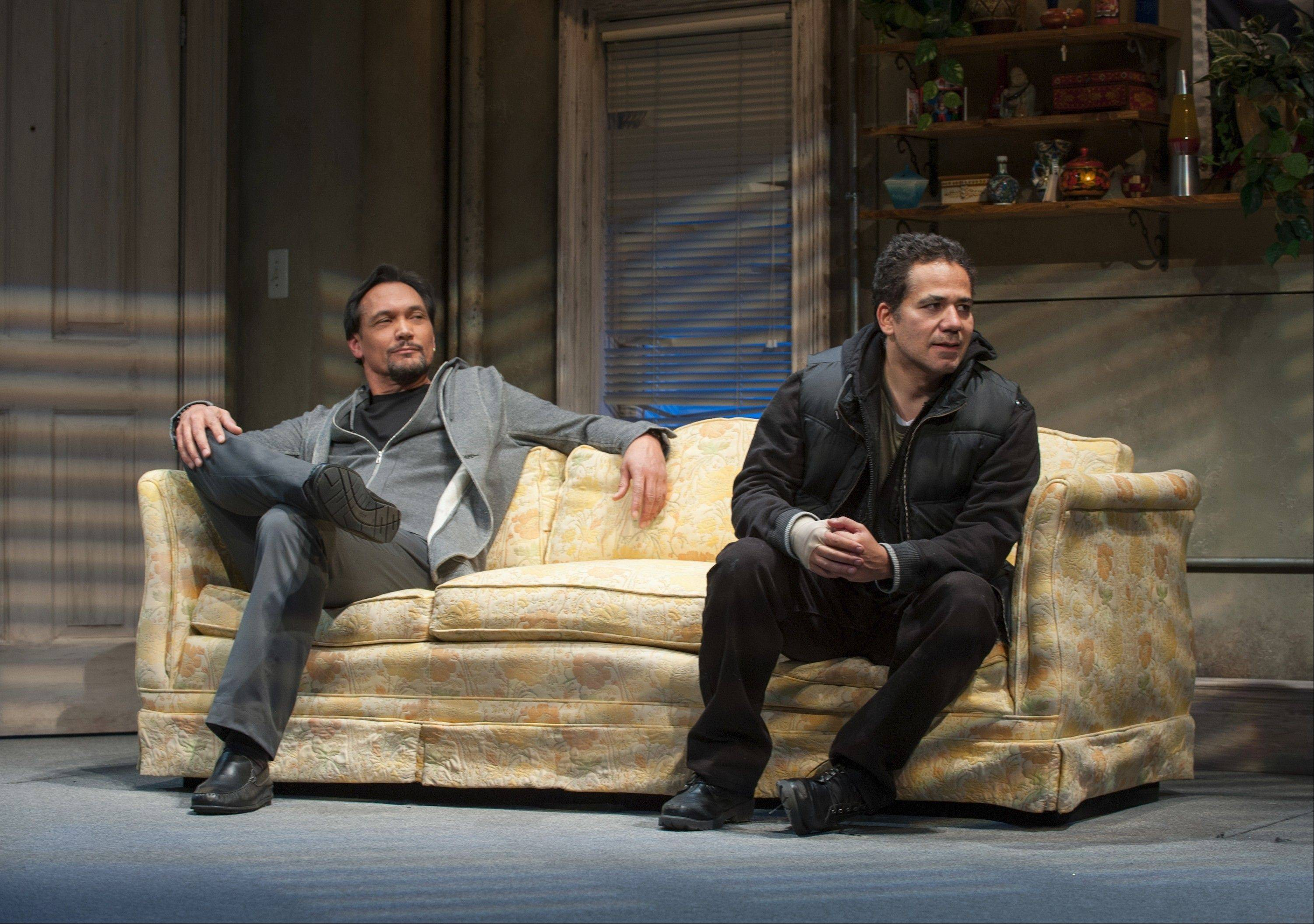 "TV and stage veteran Jimmy Smits, left, plays Ralph D., AA sponsor to John Ortiz's ex-con Jackie in Stephen Adly Guirgis' ""The (expletive) with the Hat,"" running through March 3 at Steppenwolf Theatre."