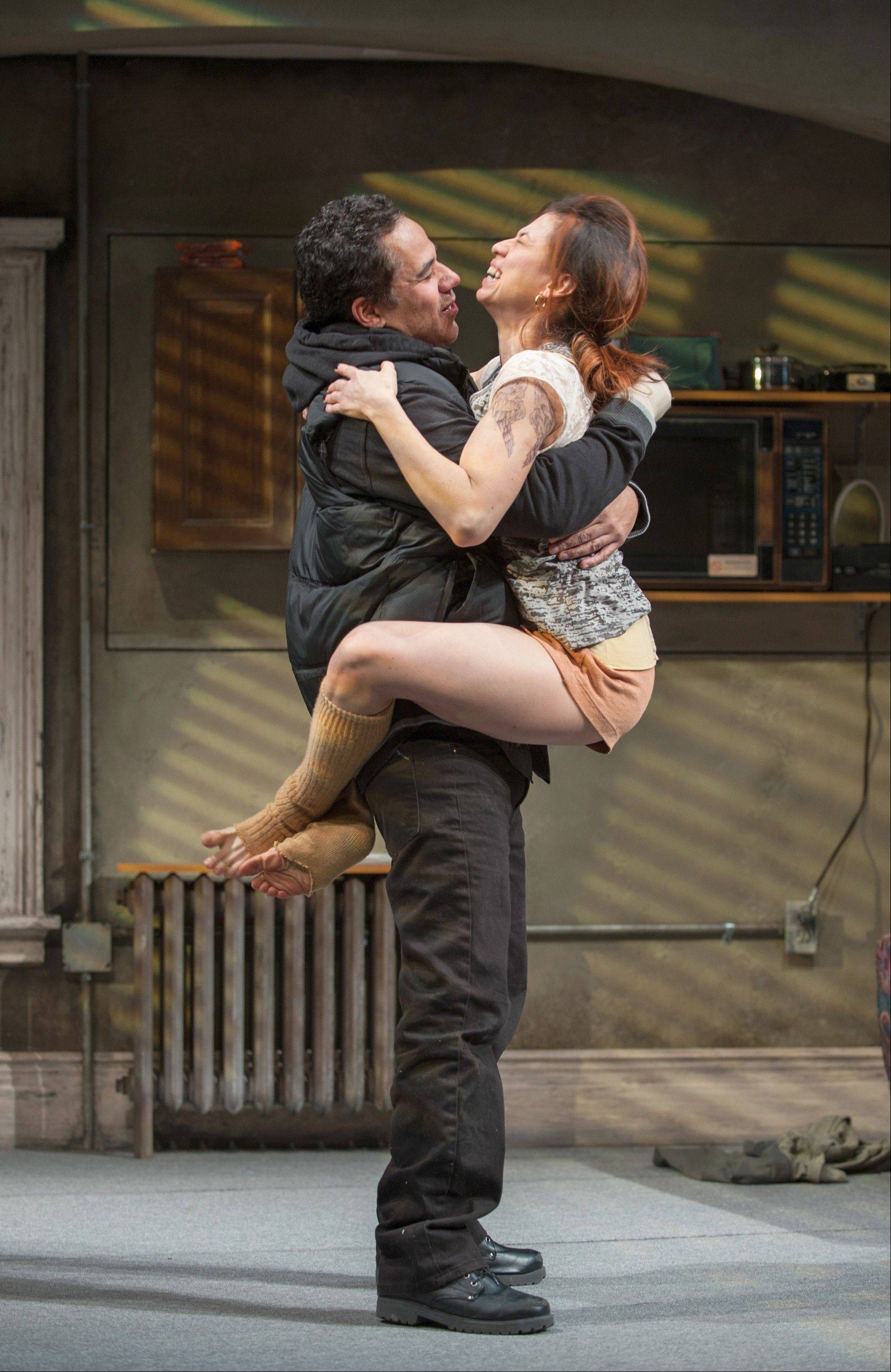 "Demons and dysfunction aside, childhood sweethearts Jackie (John Ortiz) and Veronica (Sandra Delgado) cannot get enough of each other in Steppenwolf Theatre's ""The (expletive) with the Hat."""
