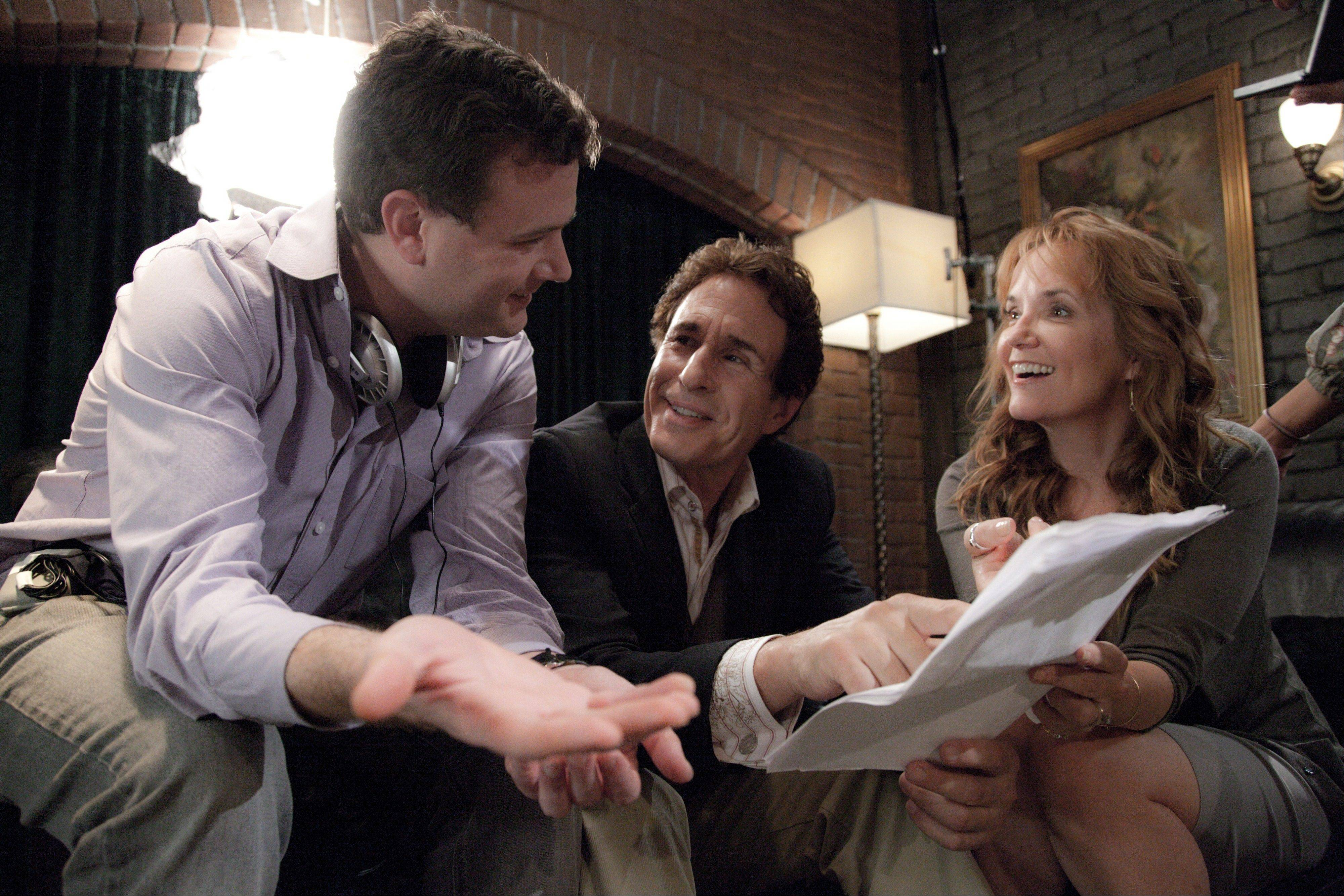 "Naperville Central High School grad Jim Hemphill, left, talks with stars John Shea and Lea Thompson on the set of ""The Trouble With the Truth,"" playing one week at Facets Multimedia in Chicago."