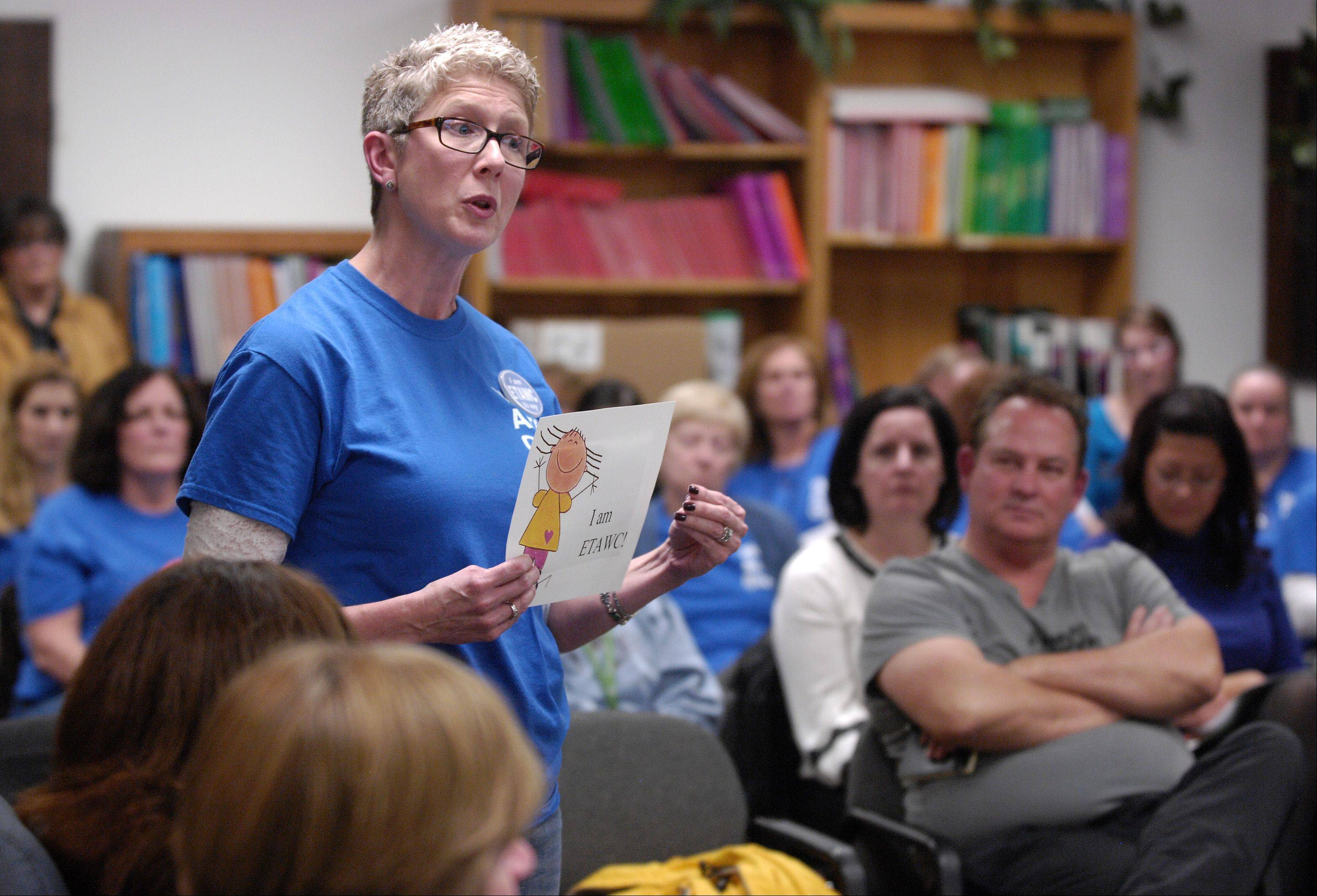 Twenty-six-year veteran teacher Melanie Dixon speaks Thursday night during the West Chicago District 33 board meeting. Dixon was one of 23 teachers who spoke in support of their union, which remains locked in contract negotiations with the board.