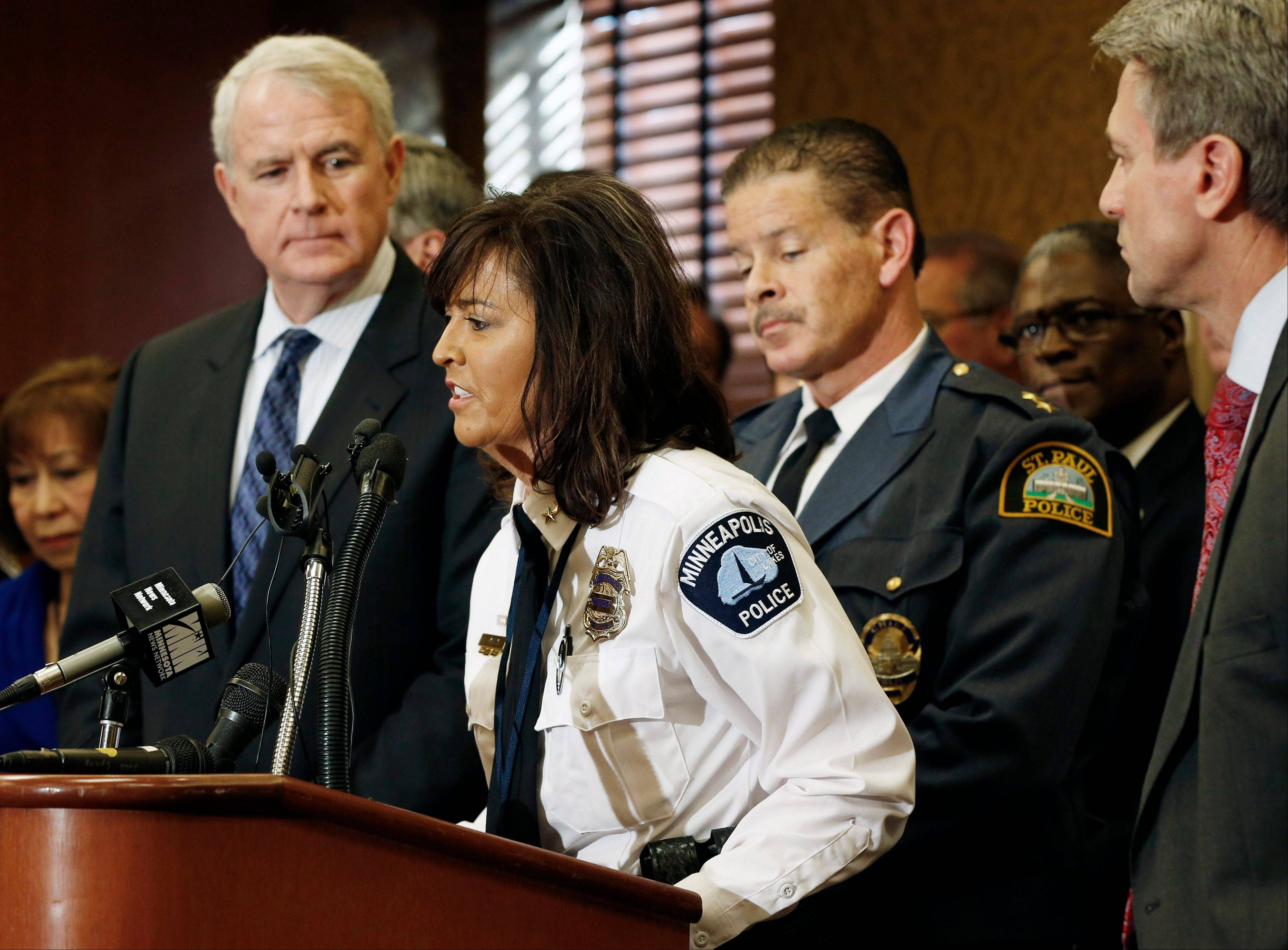 Minneapolis Police Chief Renee Harteau addresses a Regional Gun Summit news conference hosted by Minneapolis Major R.T. Rybak, right, and Milwaukee Mayor Tom Barrett, left, Thursday in Minneapolis.