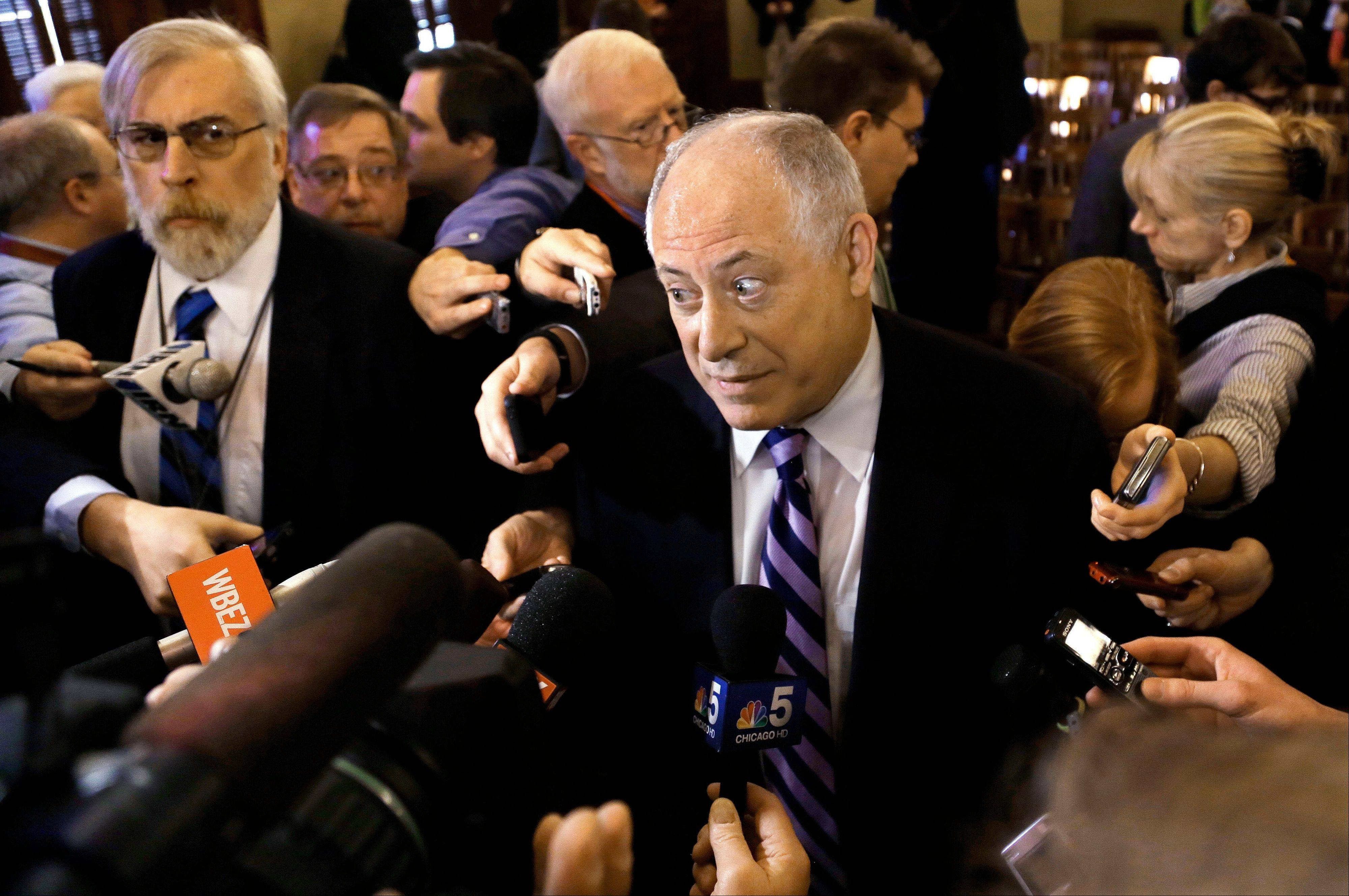 Illinois Gov. Pat Quinn is surrounded by reporters after testifying at a House committee hearing on pension reform at the Illinois State Capitol in Springfield earlier this week.