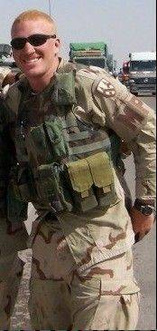 Bartlett resident James Dexter in Iraq in 2003. Dexter served in the Illinois Army National Guard from 1999 to 2007. He has had facial hair since leaving the service, but he will shave it off later this month to raise money for the Bartlett Veterans Memorial.