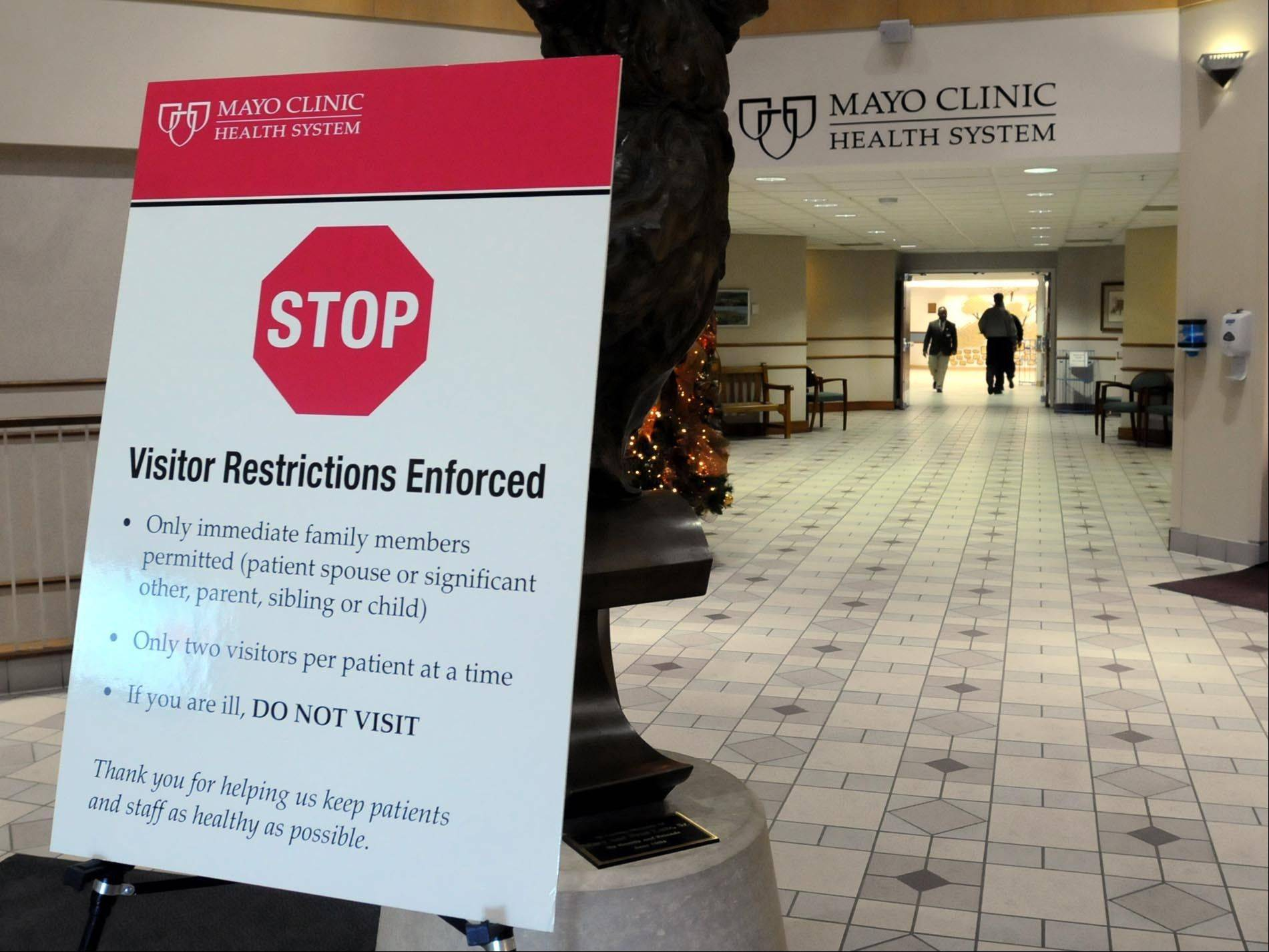 A sign in the entry of the the Mayo Clinic Health System hospital in Mankato, Minn., spells out visitor restrictions that have been implemented to curb the spread of influenza. Mayo Health Systems recently put the restrictive policy in place in 15 hospitals in southern Minnesota and South Dakota because of the flu outbreak.