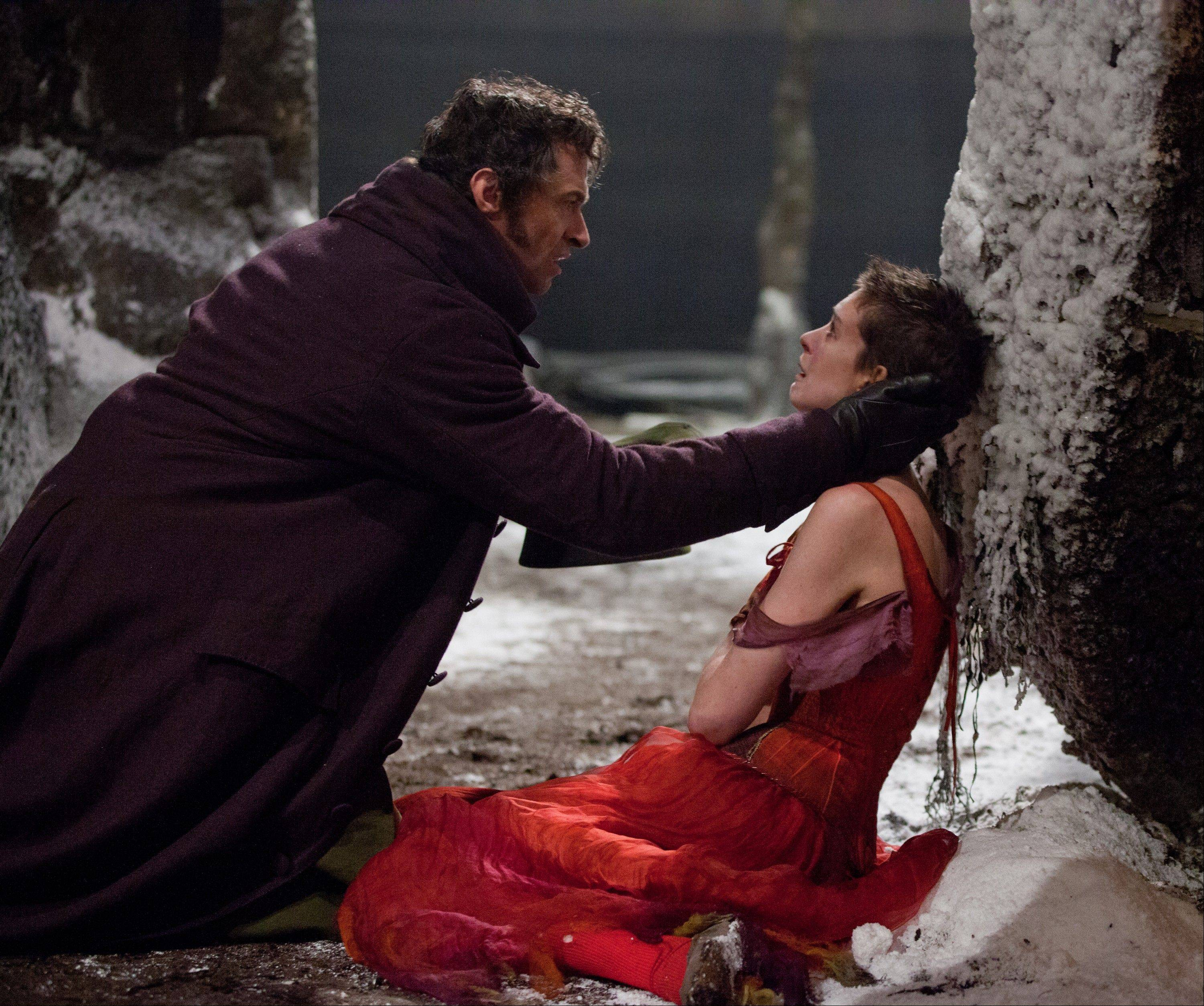 "This film image released by Universal Pictures shows Hugh Jackman as Jean Valjean, left, and Anne Hathaway as Fantine in a scene from ""Les Miserables."" The film was nominated for an Academy Award for best picture on Thursday, Jan. 10, 2013."