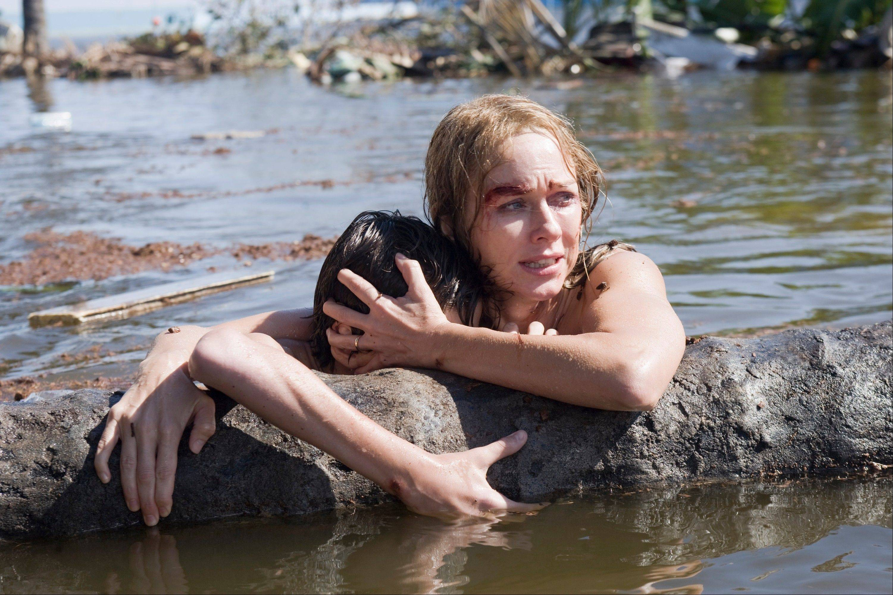 "This film image released by Summit Entertainment shows Tom Holland, left, and Naomi Watts in a scene from ""The Impossible."" Watts was nominated for an Academy Award for best actress on Thursday, Jan. 10, 2013, for her role in the film."