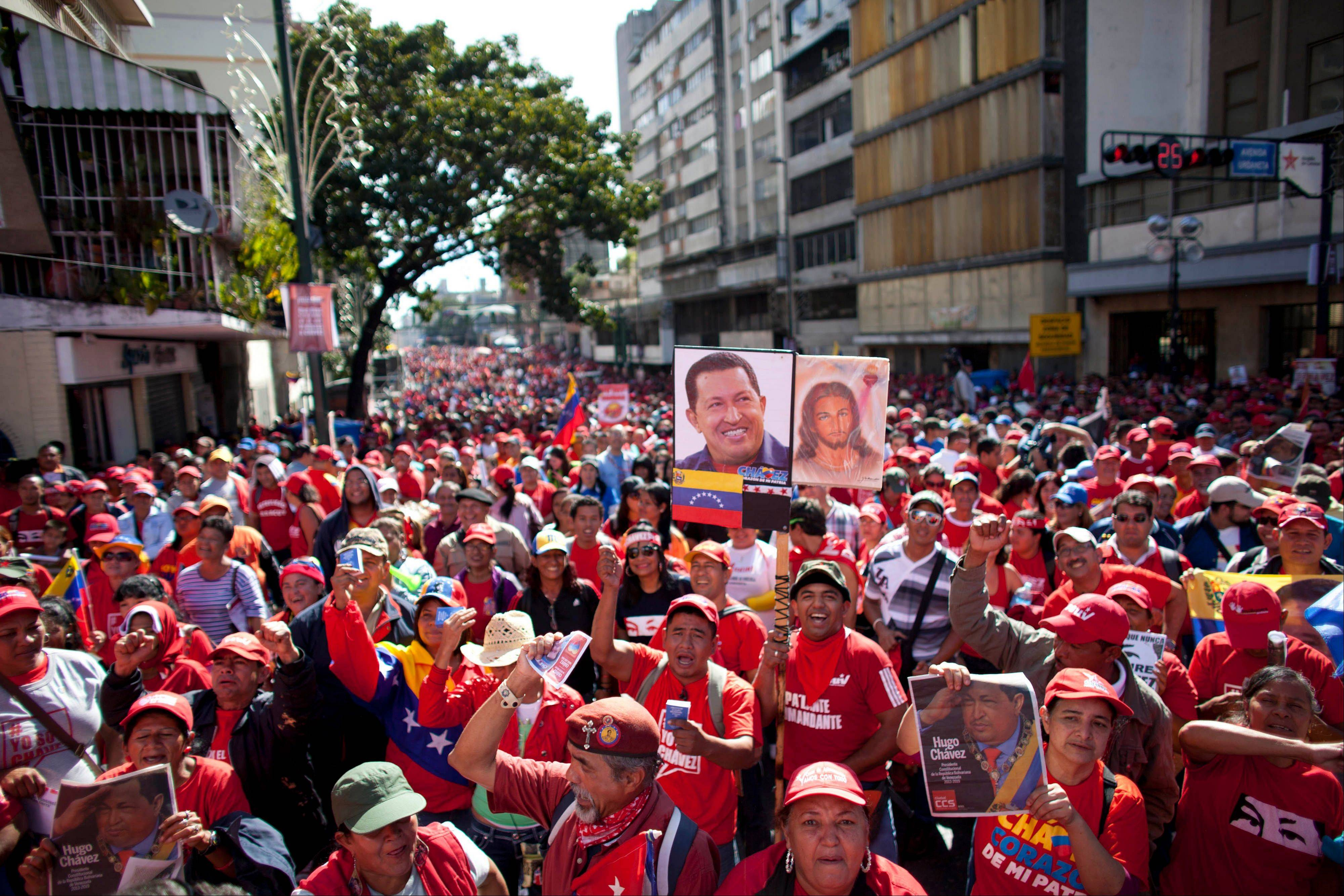 Supporters of Venezuela's President Hugo Chavez chants slogans during a rally in Caracas, Venezuela, Thursday, Jan. 10, 2013. Hundreds of cheerful supporters rallied outside his presidential palace Thursday in an alternative inauguration for a leader too ill to return home for the real thing.