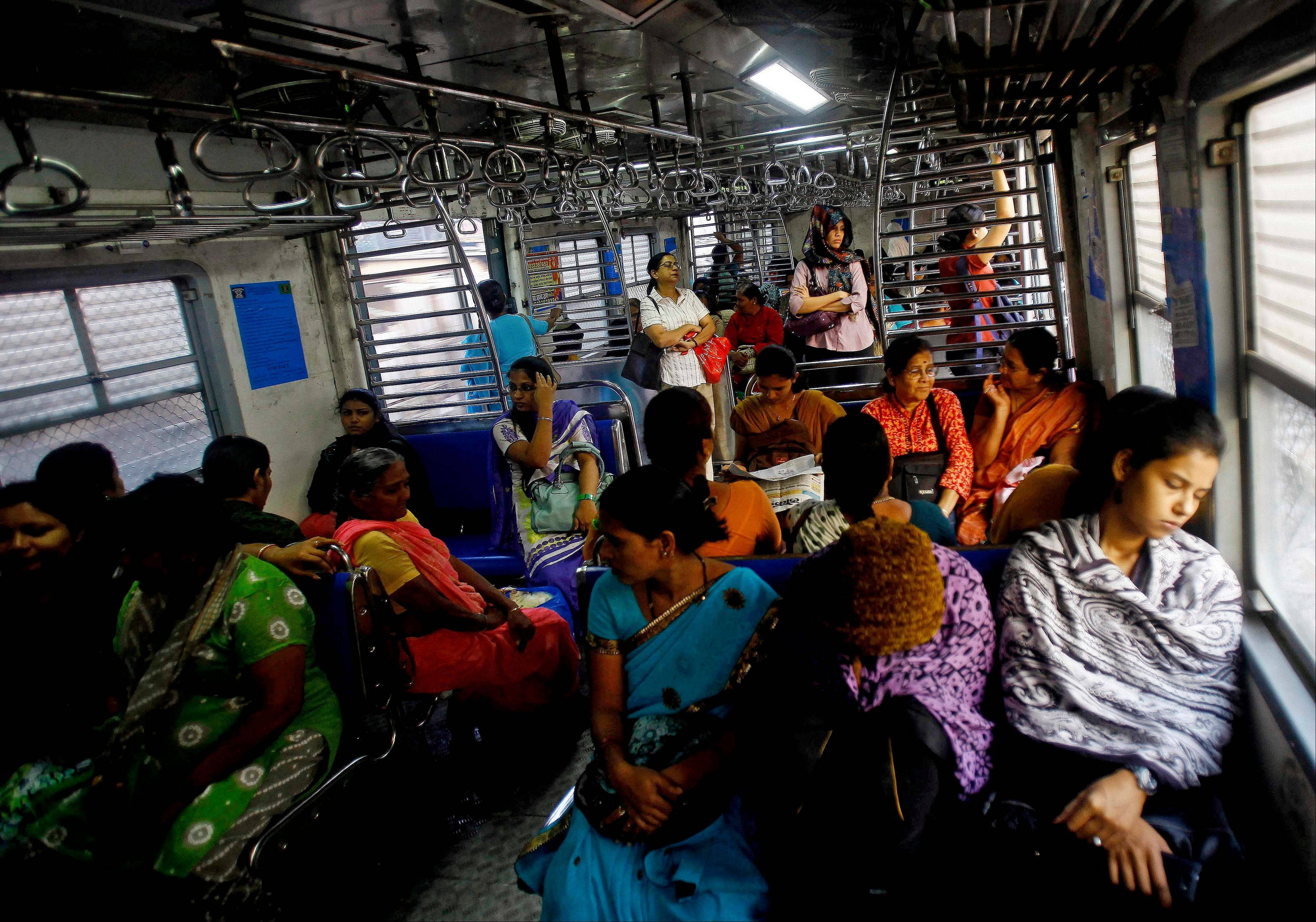 Indian women travel in the women's compartment of a train early morning in Mumbai, India, Thursday, Jan. 10, 2013. Five men have been charged with attacking the 23-year-old woman and a male friend on a bus as it was driven through the streets of India's capital. The woman was raped and assaulted with a metal bar on Dec. 16, 2012 and eventually died of her injuries. The case has sparked protests across India by women and men who say India's legal system doesn't do enough to prevent attacks on women.