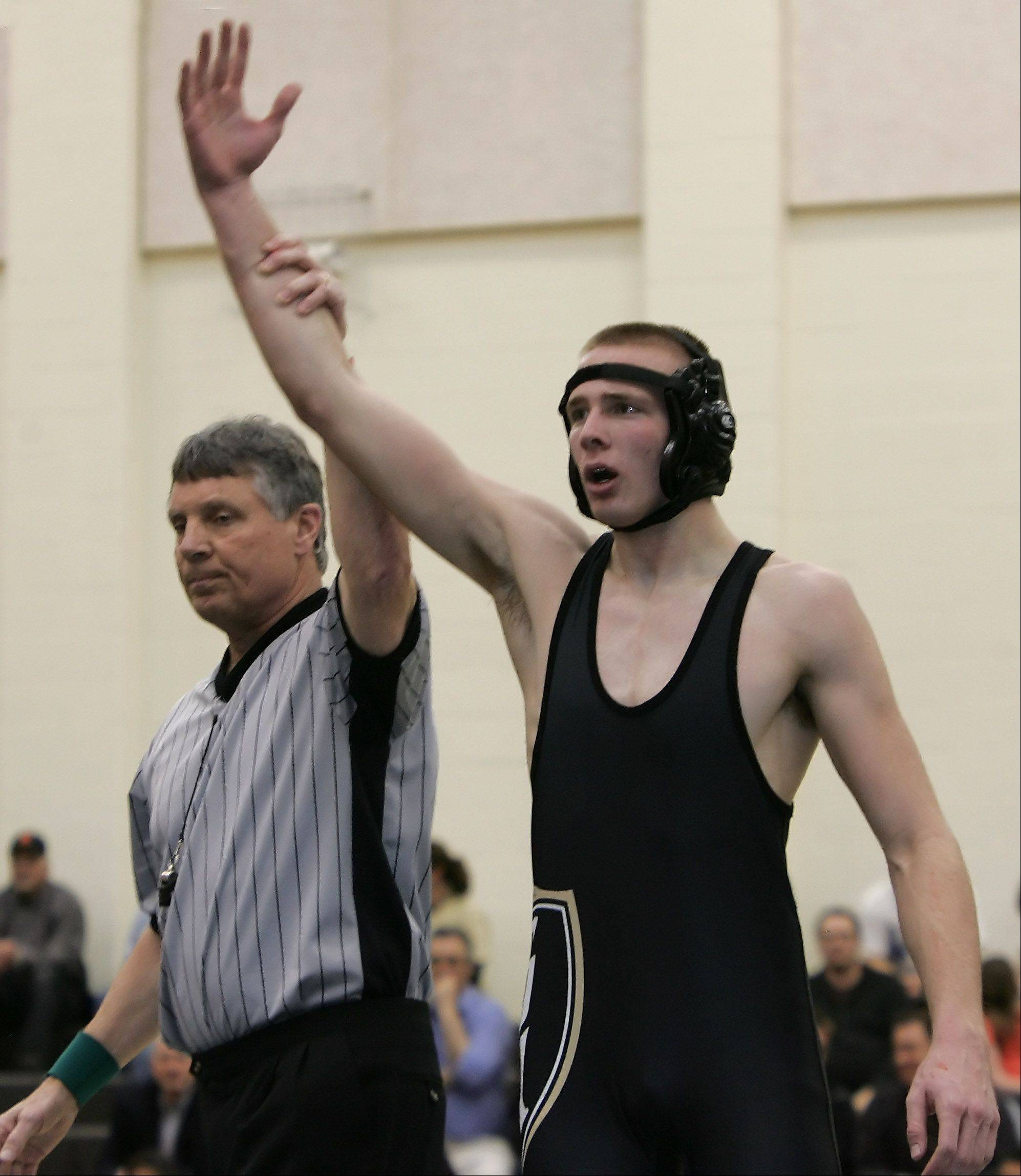 Grayslake North wrestler Ian Pearce wins the 182-pound bout against Grayslake Central on Thursday at Grayslake North.