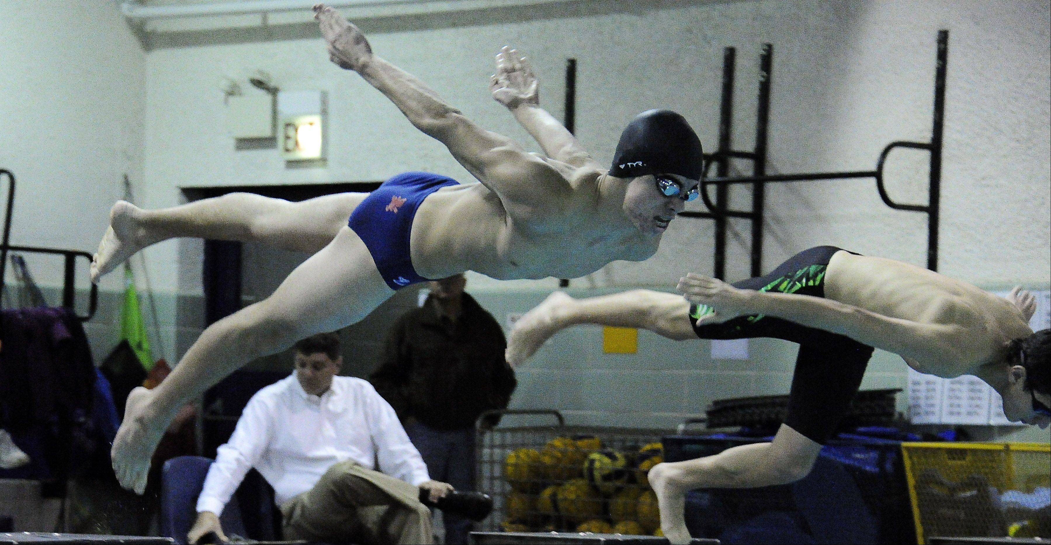 St. Viator's Keegan Finn leaves the starting block in the 100 freestyle, winning in 55.16 against Notre Dame at St. Viator on Thursday.