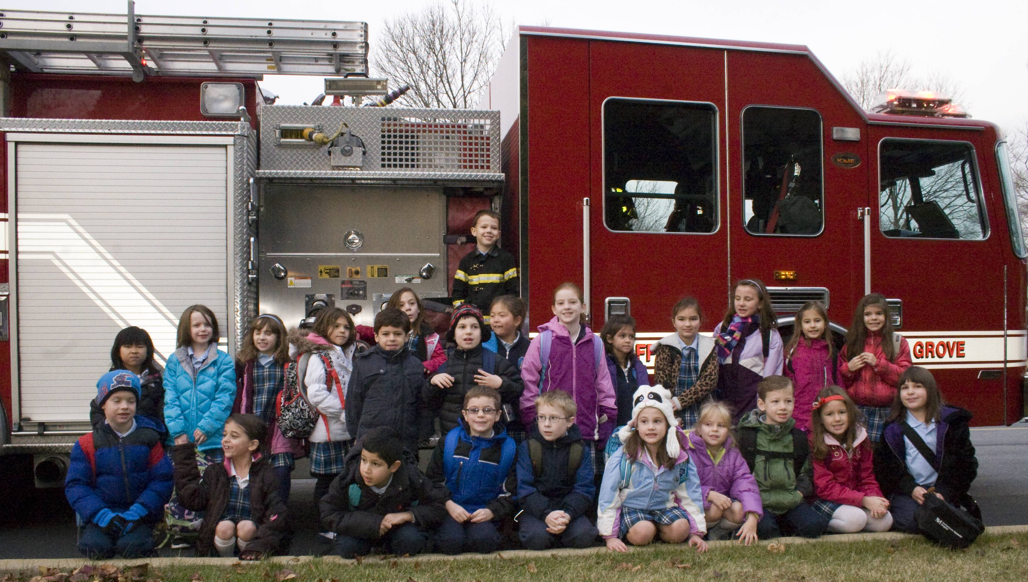 Saint Mary BG second grader Kiernan Deer with his class after their ride on a Buffalo Grove fire truck