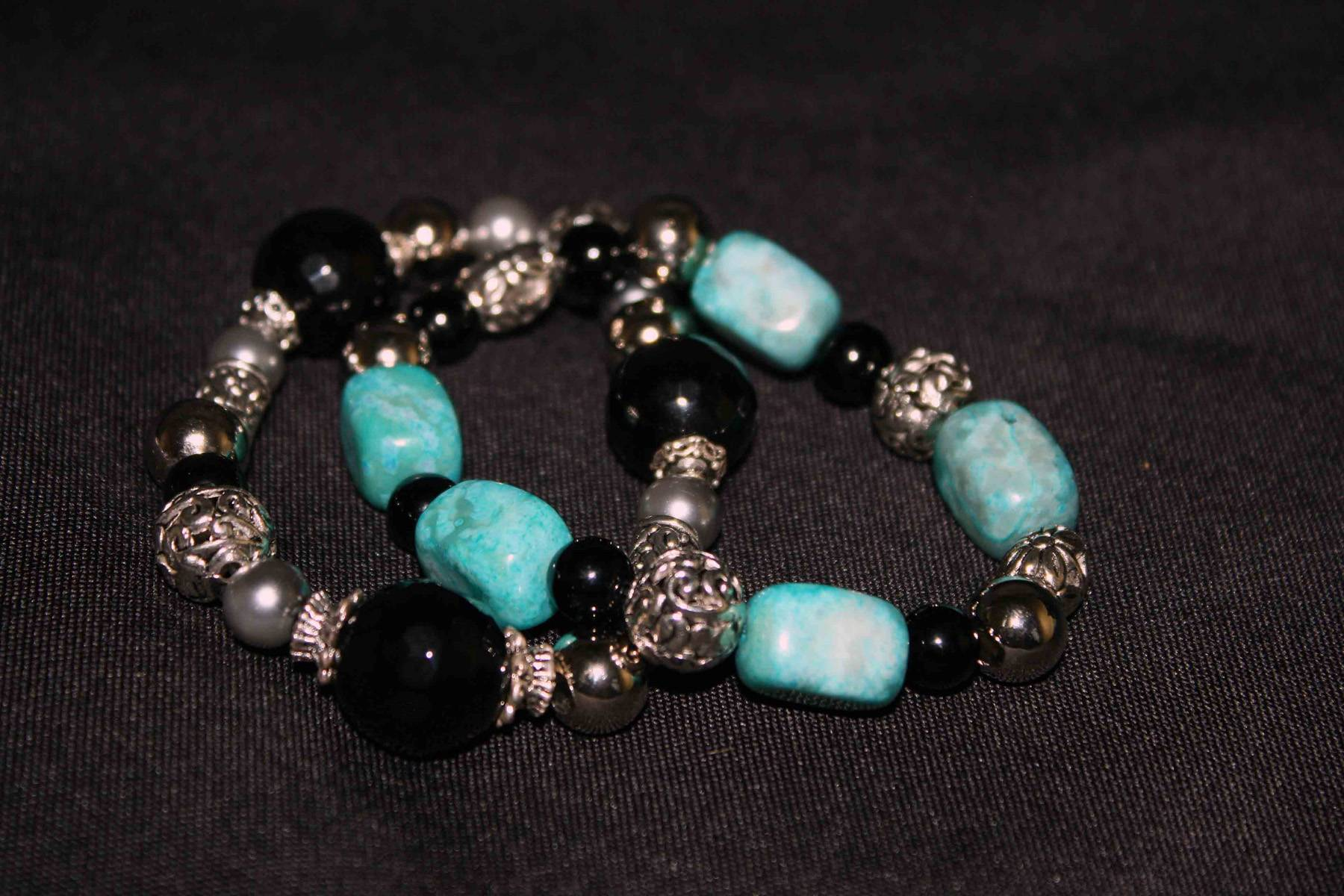 The turquoise and black agate bracelet is an example of the one that participants will create in the Stretch Bead Bracelet class with Britta Renwick on January 25, 2013 at Gallery 200 in West Chicago.