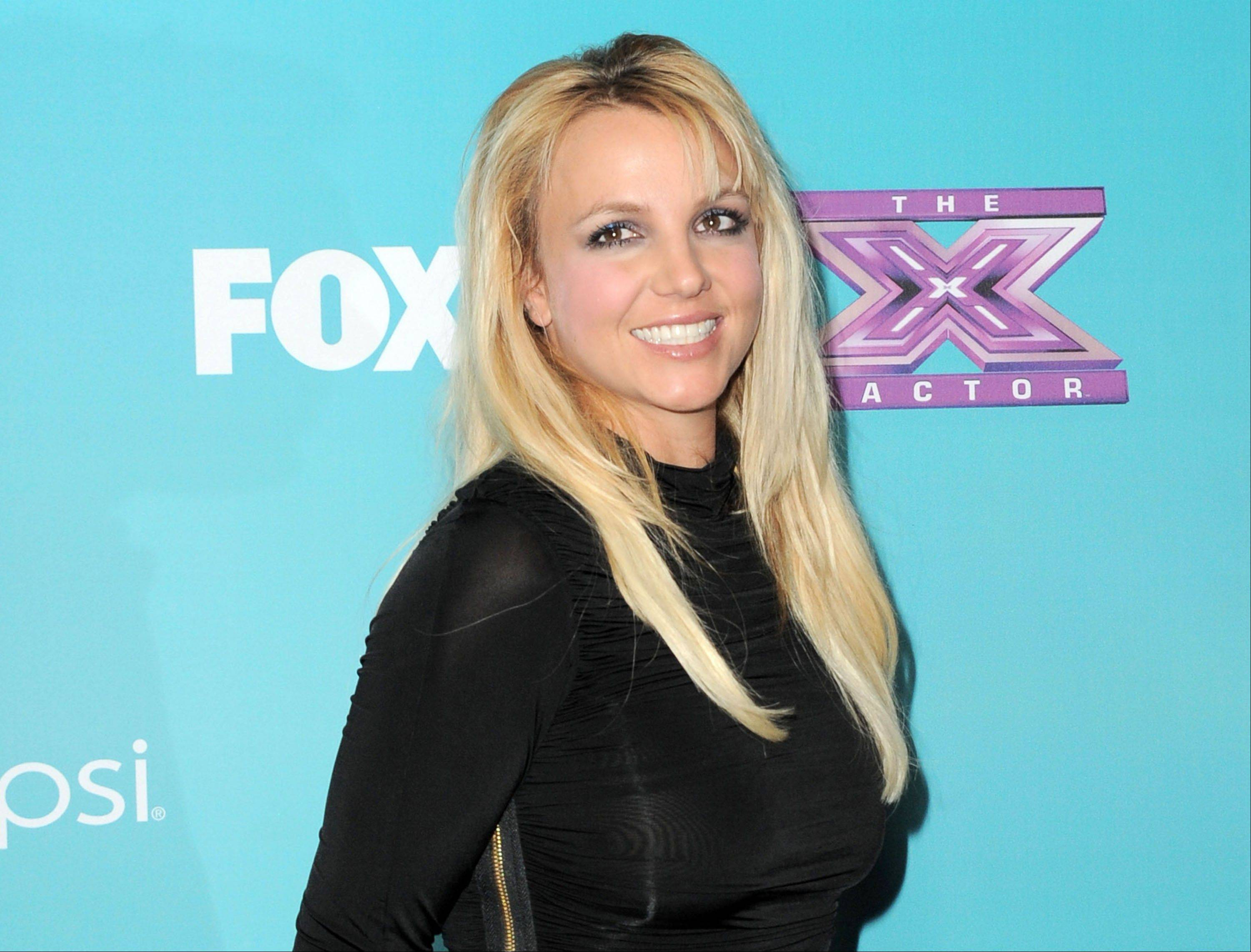 A person familiar with plans for Fox�s �The X Factor� says Britney Spears is out of the show. Spears was a mentor on the singing contest for one season, reportedly drawing a $15 million paycheck but failing to pull reviews to match.