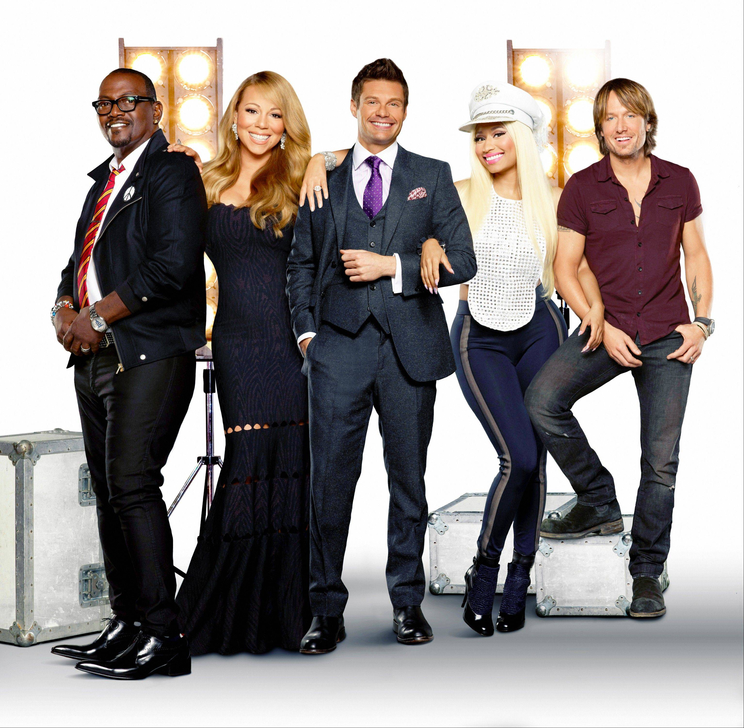 "Returning judge Randy Jackson, left, joins with new judges Mariah Carey, Nicki Minaj and Keith Urban — as well as host Ryan Seacrest, center — when ""American Idol"" returns to Fox Wednesday, Jan. 16."