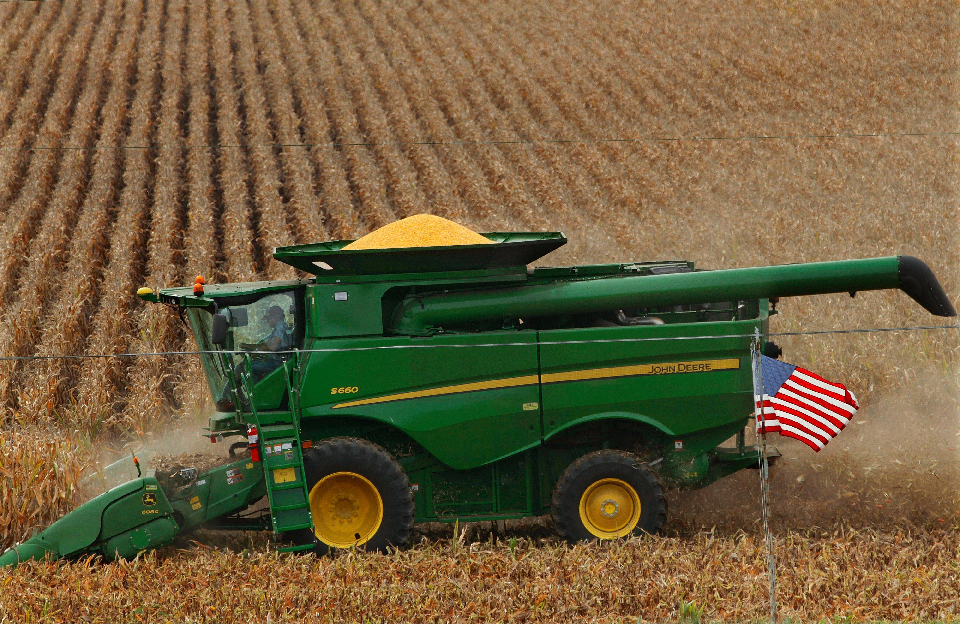 Associated Press/September 2012 A central Illinois corn farmer harvest his crops in Oreana.