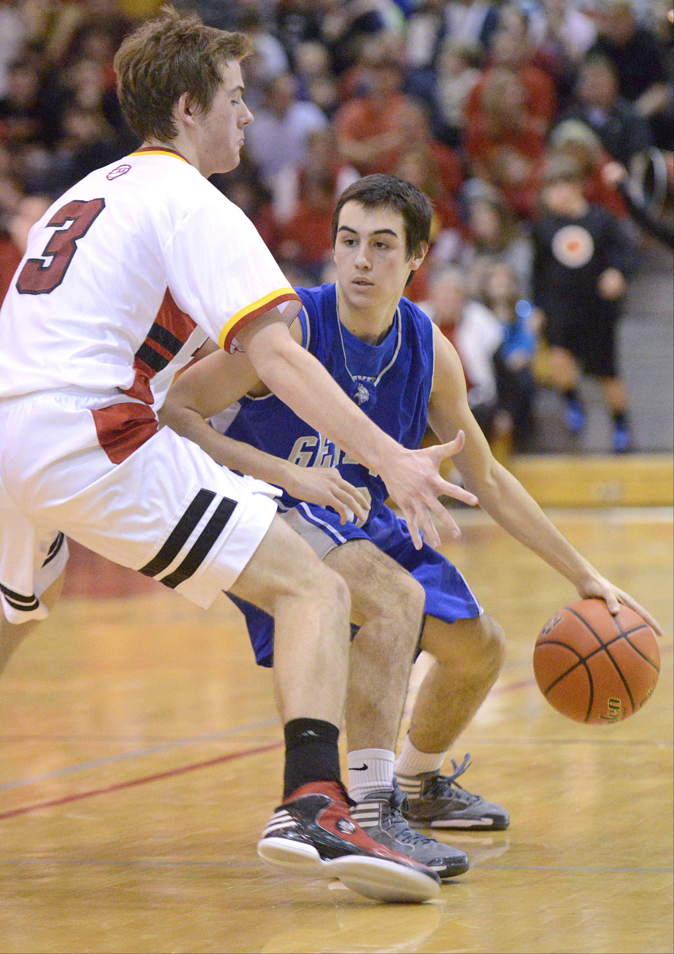 Geneva�s Pat McCaffrey maneuvers his way around a block by Batavia�s Jake Pollack in the fourth quarter on Friday, January 11.