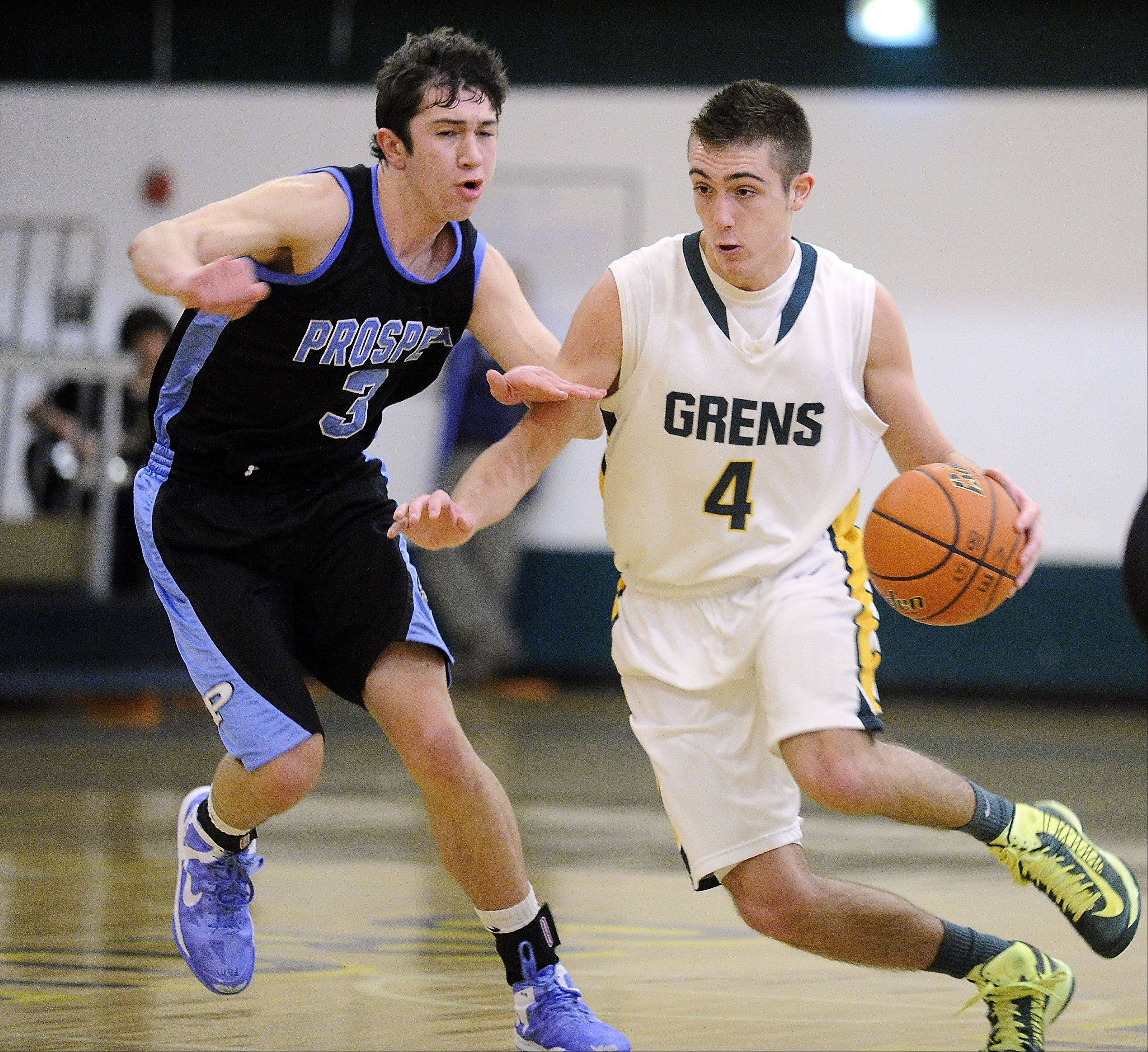 Elk Grove�s Austin Amann tries to dribble-drive around Prospect�s Bobby Frasco en route to the basket at Elk Grove.