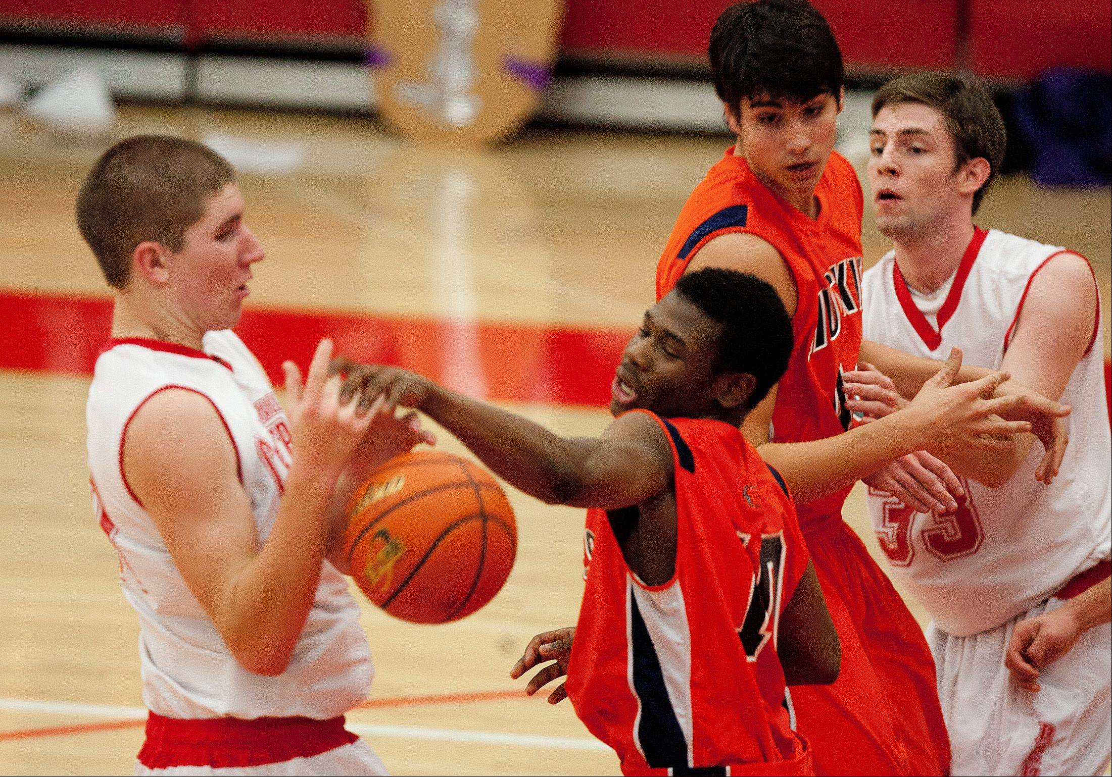 Naperville North�s Jelani McClain Jr., center, fights for possession.