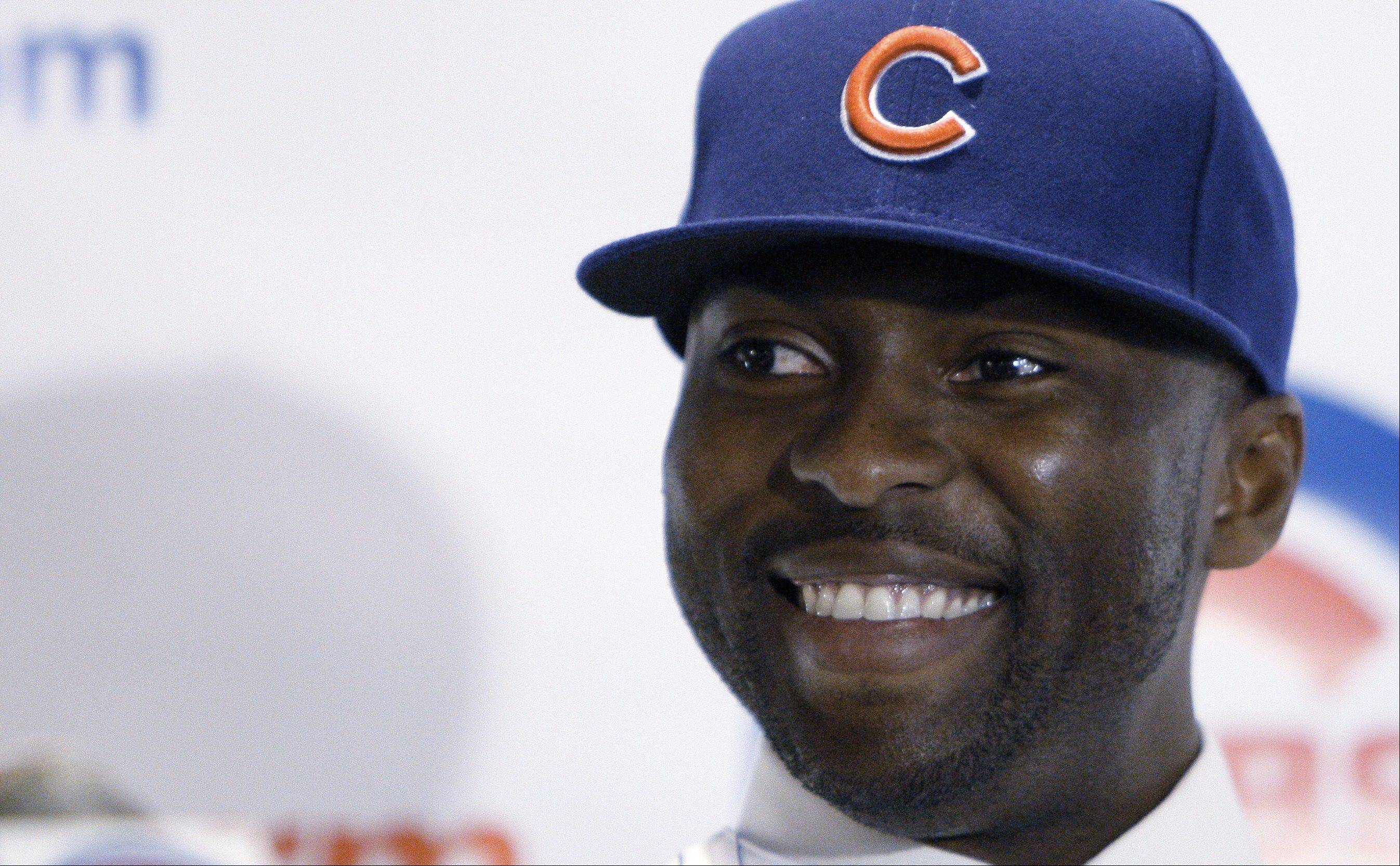 Chicago Cubs outfielder Milton Bradley smiles as he is introduced as the newest member of the team during a news conference Thursday, Jan. 8, 2009 in Chicago. Bradley, formerly with the Texas Rangers, signed a three-year contract with the Cubs. (AP Photo/M. Spencer Green)