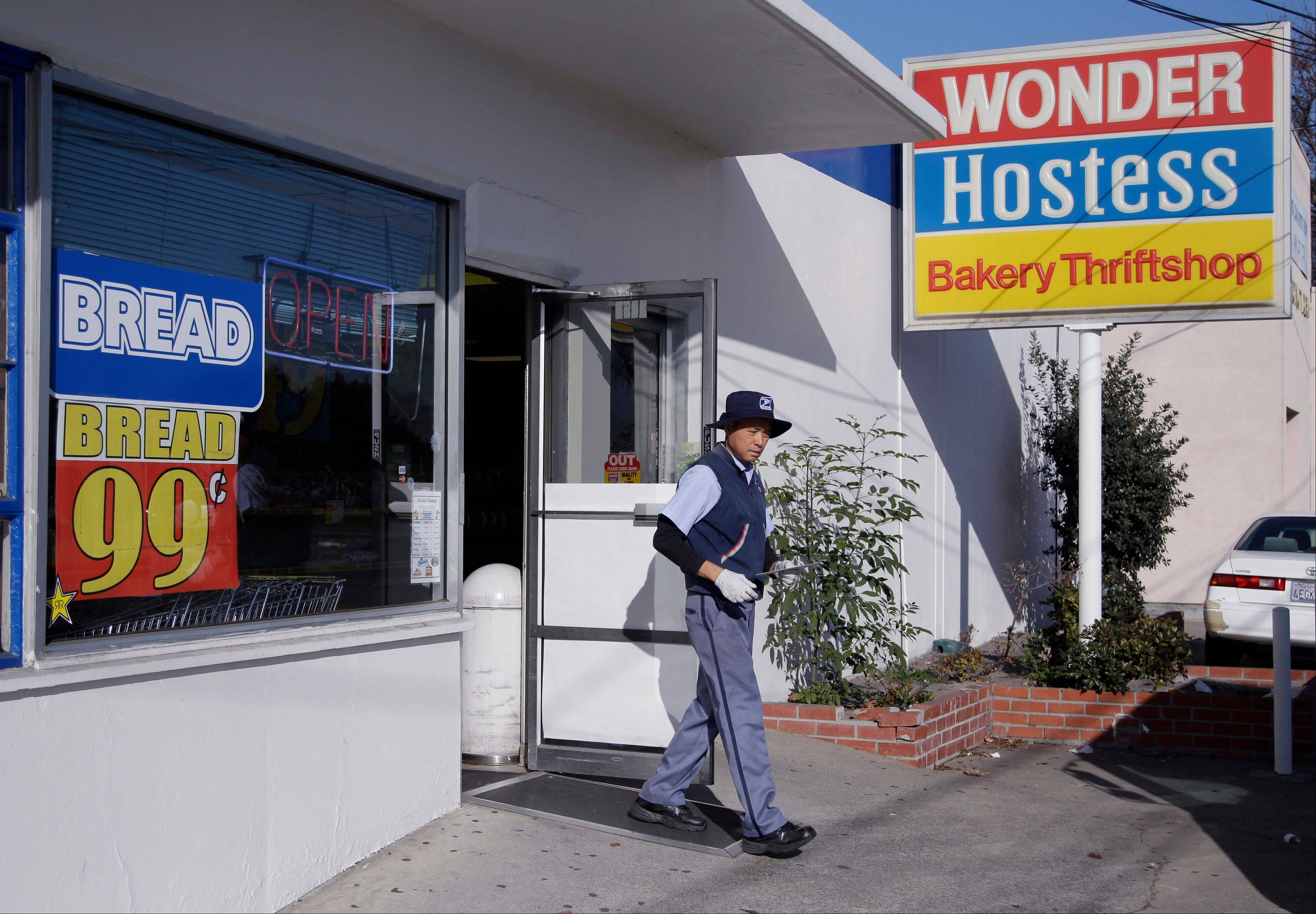 A postal worker leaves a Hostess Wonder grocery store in Santa Clara, Calif.