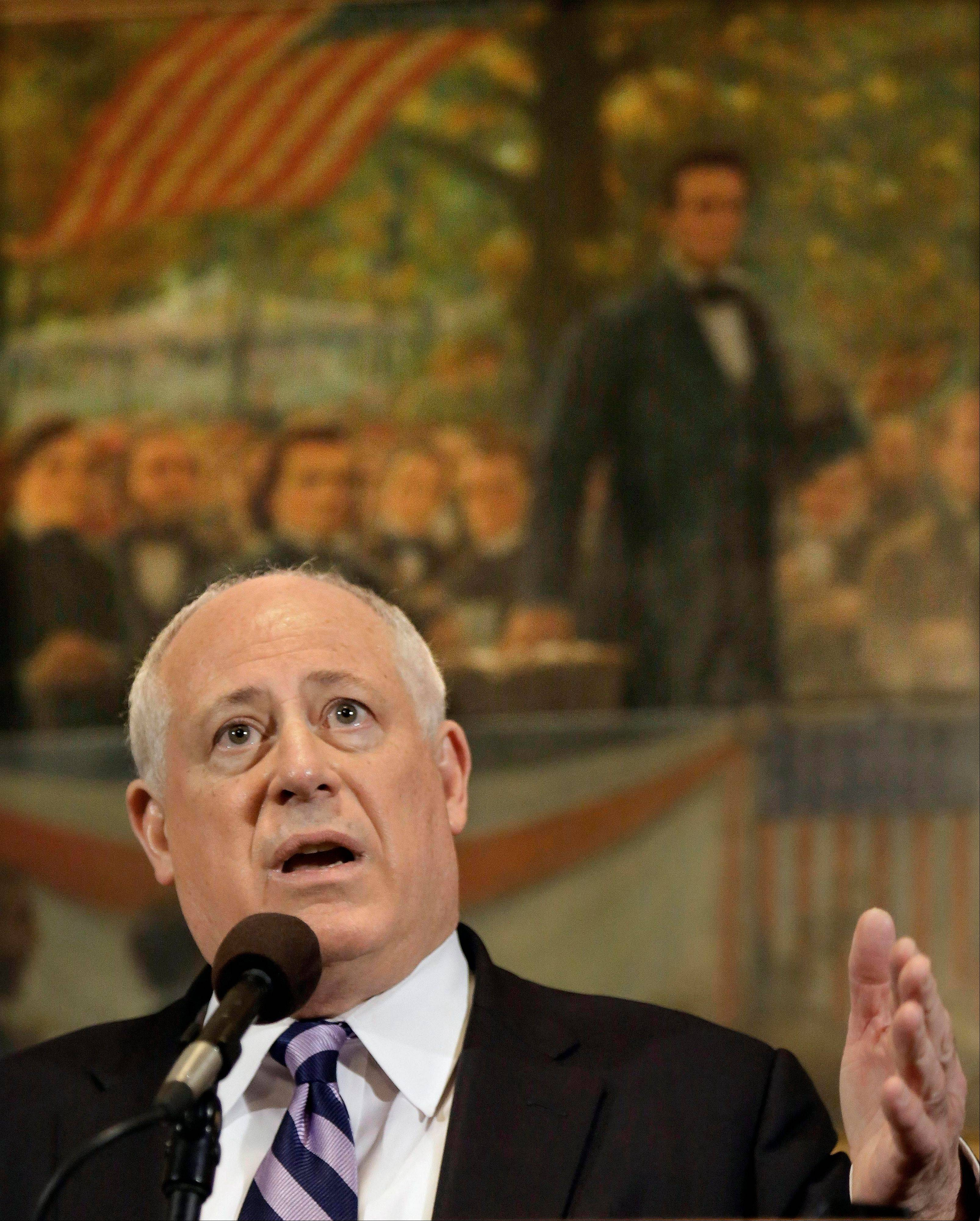 Illinois Gov. Pat Quinn speaks to reporters Wednesday on pension reform legislation.